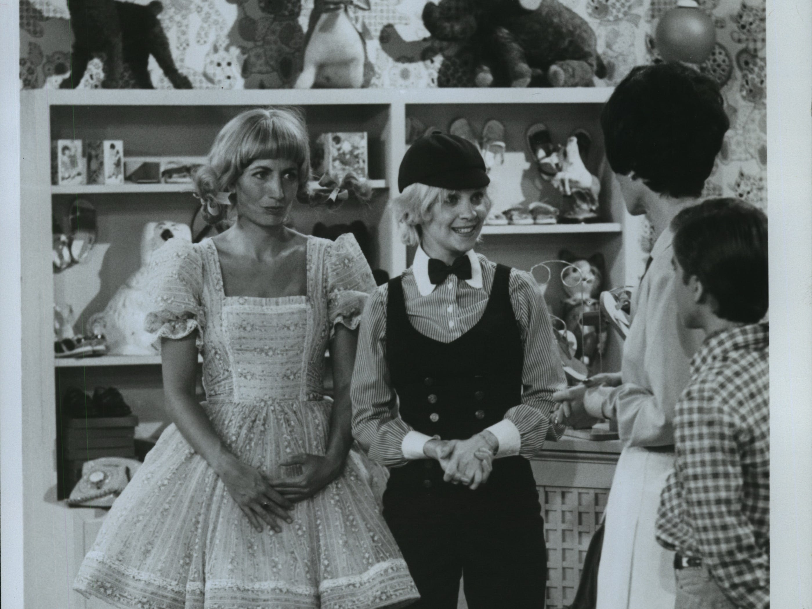 """Laverne and Shirley (Penny Marshall, left and Cindy Williams) are forced to take a job at a children's shoe shop when they find themselves short of money for a five-day cruise on """"Laverne & Shirley."""""""