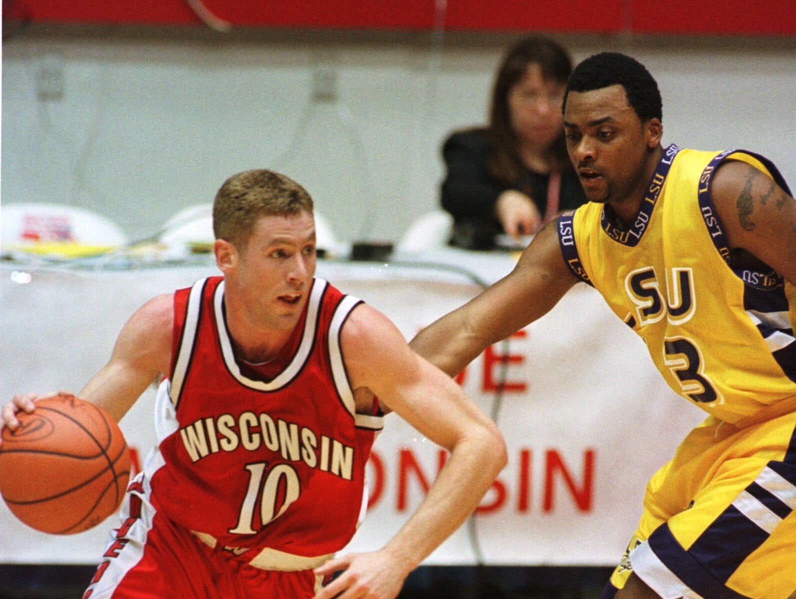 Wisconsin's Jon Bryant (10) drives around LSU's Torris Bright during the second half Thursday, March 23, 2000, of the NCAA West Regional in Albuquerque, N.M. Bryant led Wisconsin with 16 points in their 61-48 victory.