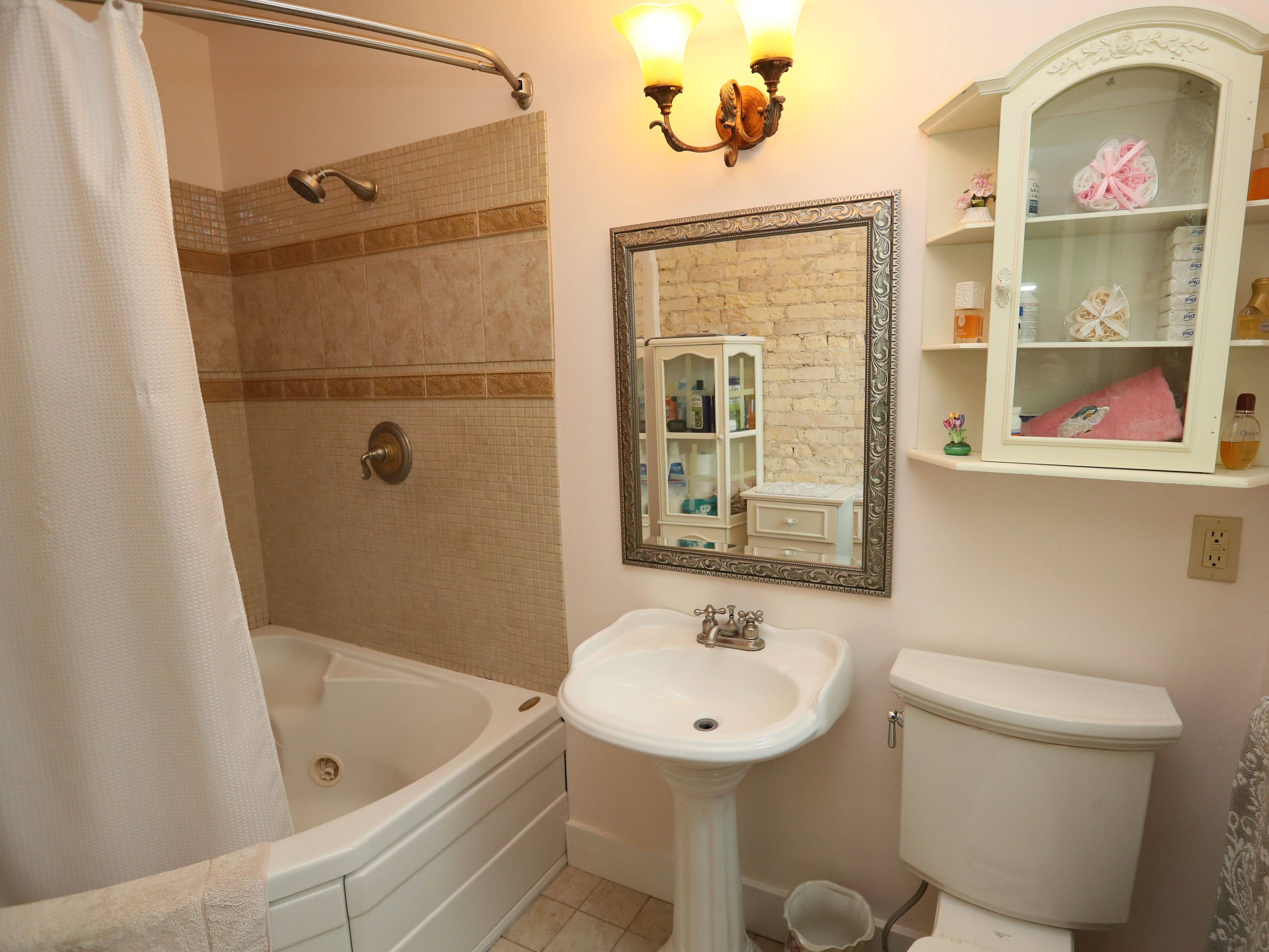 The master bathroom is one of three full baths in the house.