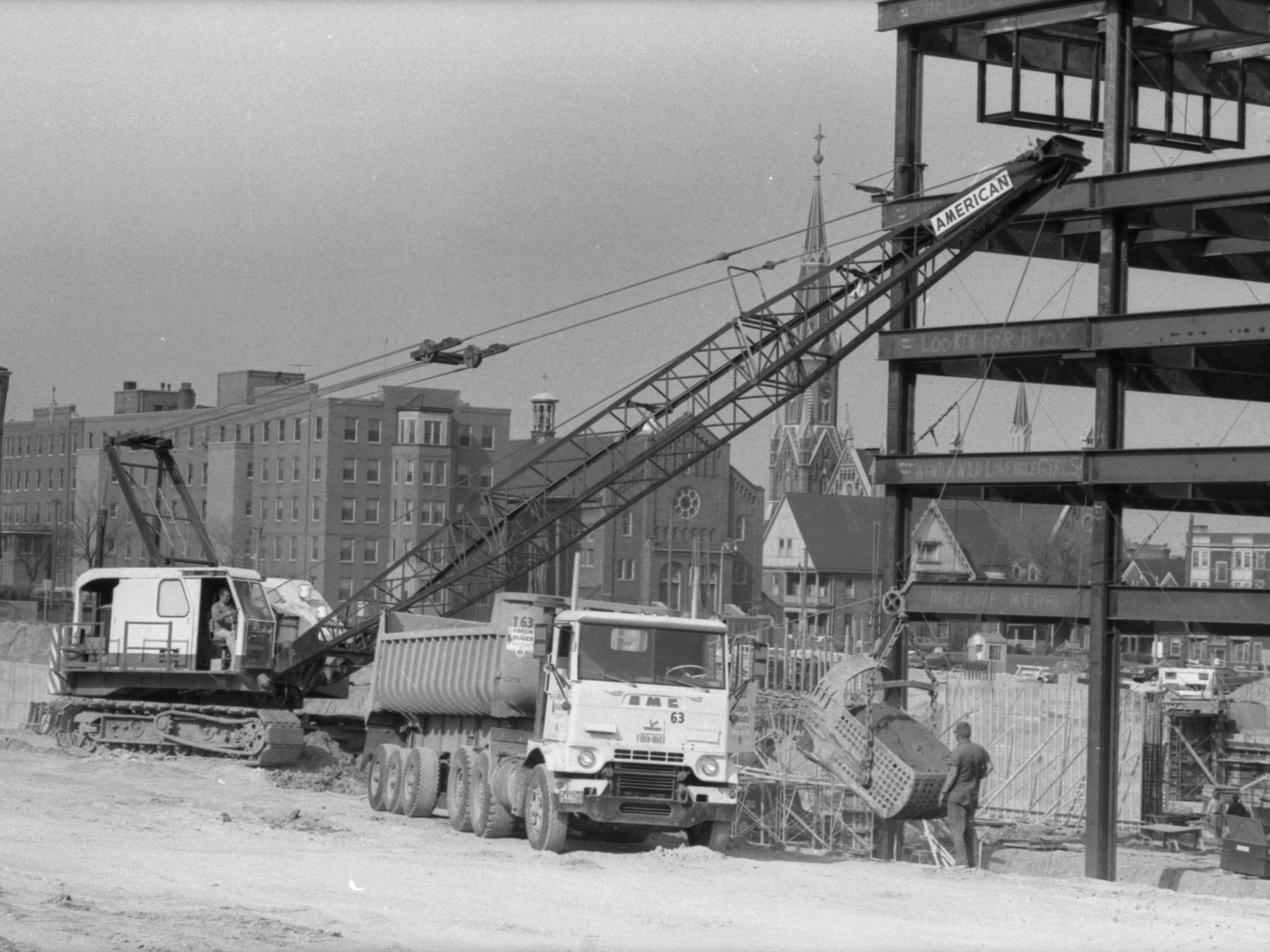 Construction workers scramble during the spring of 1968 to make progress on the new County Courthouse Annex, which will straddle the northbound North-South Freeway just north of the Marquette Interchange.