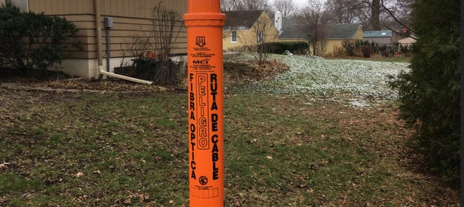 Those orange markers that are popping up all around the area show where 4G Verizon fiber optic cable is.  The company is upgrading the cable that could eventually be used for 5G, a company spokesman said.