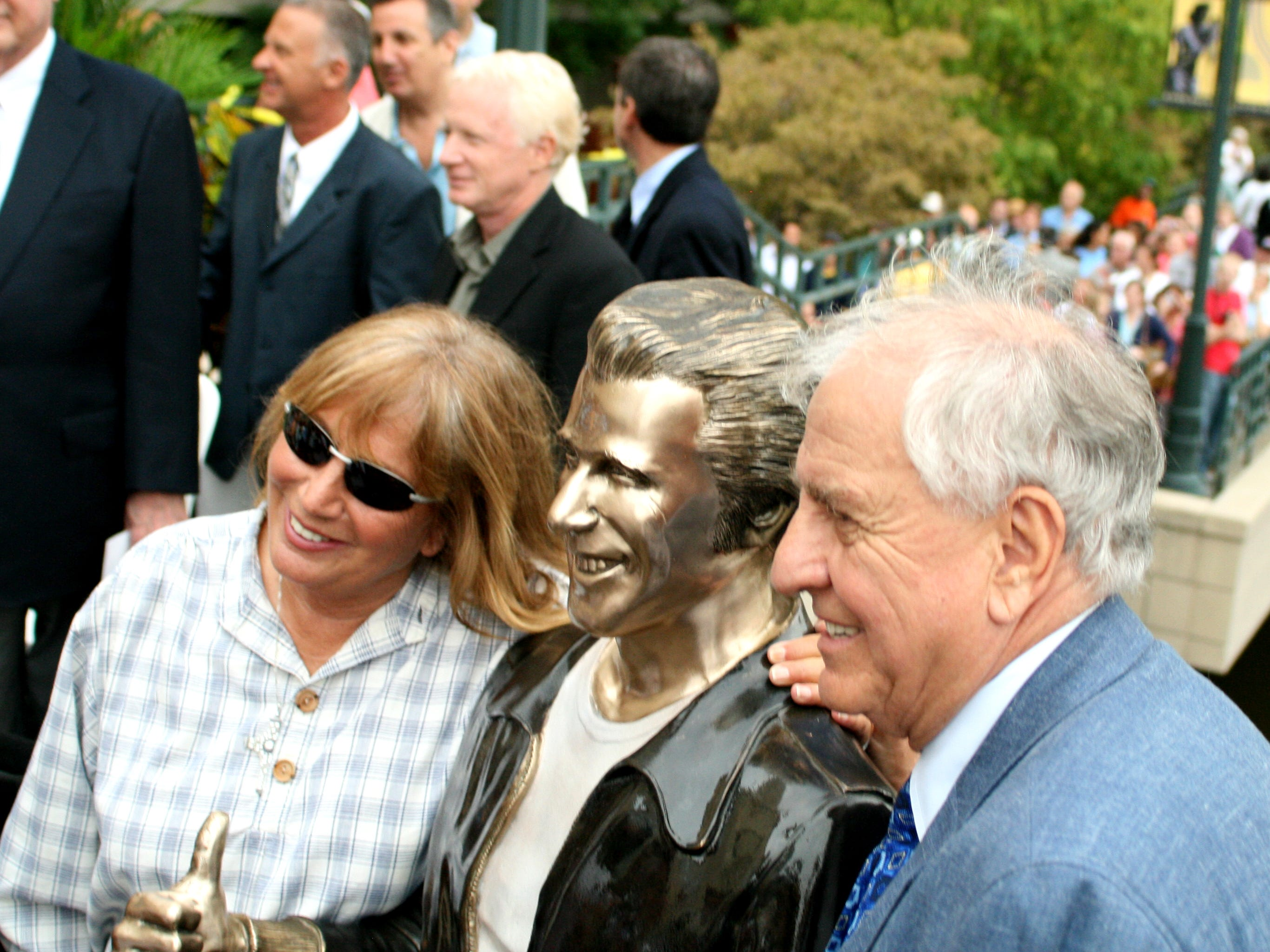 """Penny Marshall (left) poses with her brother, """"Happy Days"""" creator Garry Marshall, as they stand with a bronze statue of the """"Happy Days"""" character Arthur Fonzarelli, also known as """"The Fonz,"""" at the """"Bronz Fonz's"""" unveiling in Milwaukee on Aug. 19, 2008"""