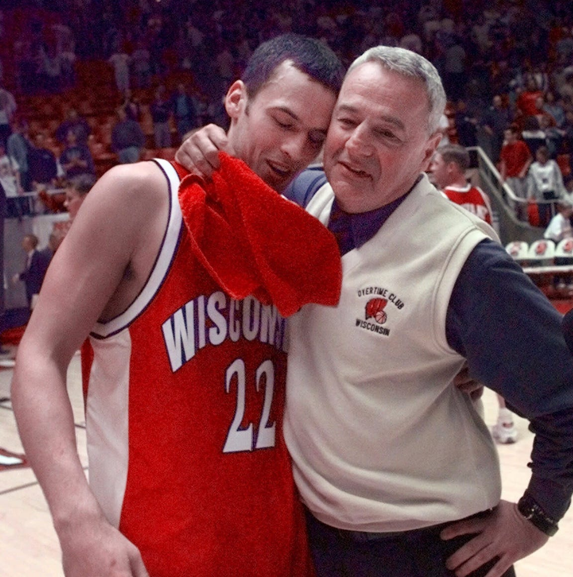 Wisconsin coach Dick Bennett hugs Mike Kelley after Arizona was upset 66-59 by Wisconsin in the second round of the NCAA West Regionals, Saturday, March 18, 2000.