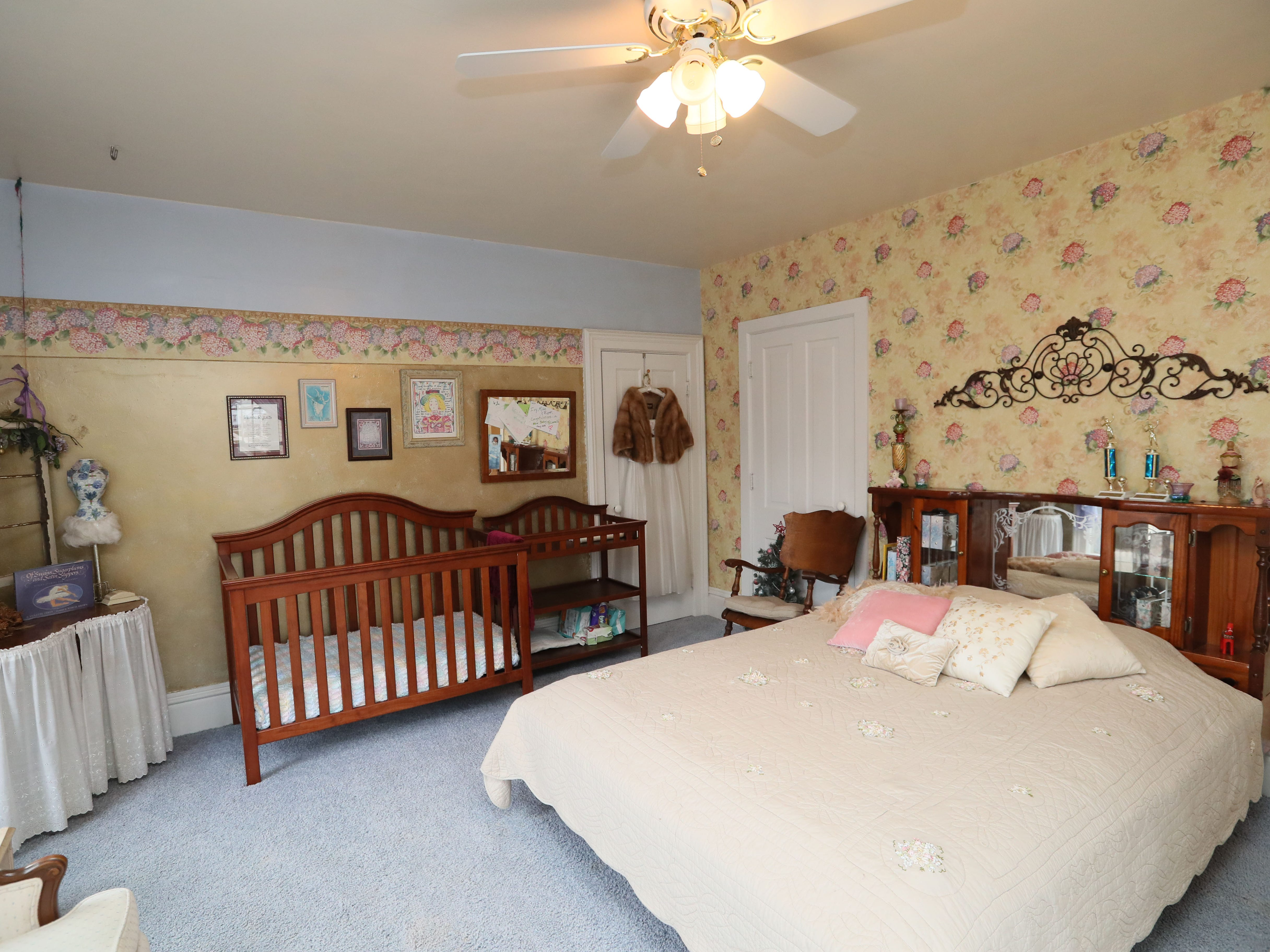 This guest bedroom had been their daughter's when she lived at home.