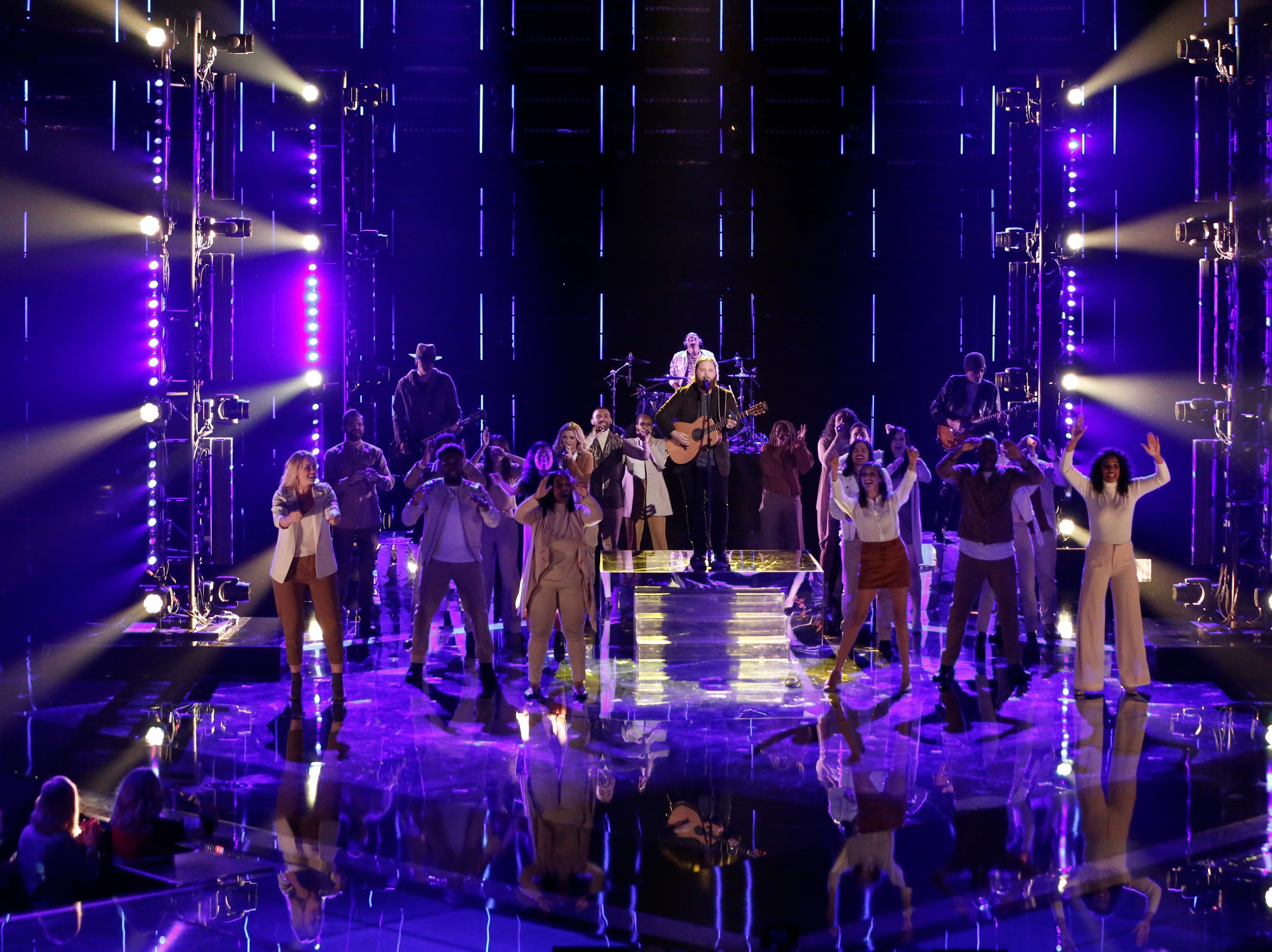 """Supported by a choir, Chris Kroeze debuted a moving original tune, """"Human,"""" during part one of """"The Voice"""" finale on Dec. 17."""