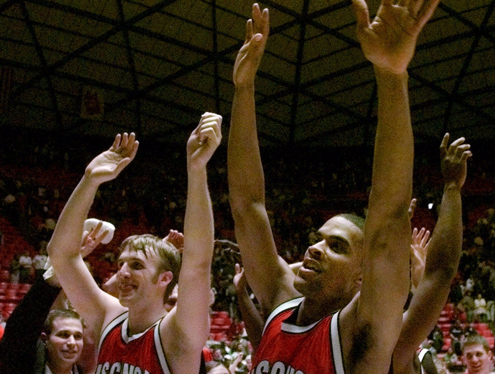Wisconsin forwards Mark Vershaw (50) and Maurice Linton (5) wave as they sing the school song after Wisconsin beat Arizona 66-59 in the second round of the NCAA West Regionals, Saturday, March 18, 2000, in Salt Lake City.