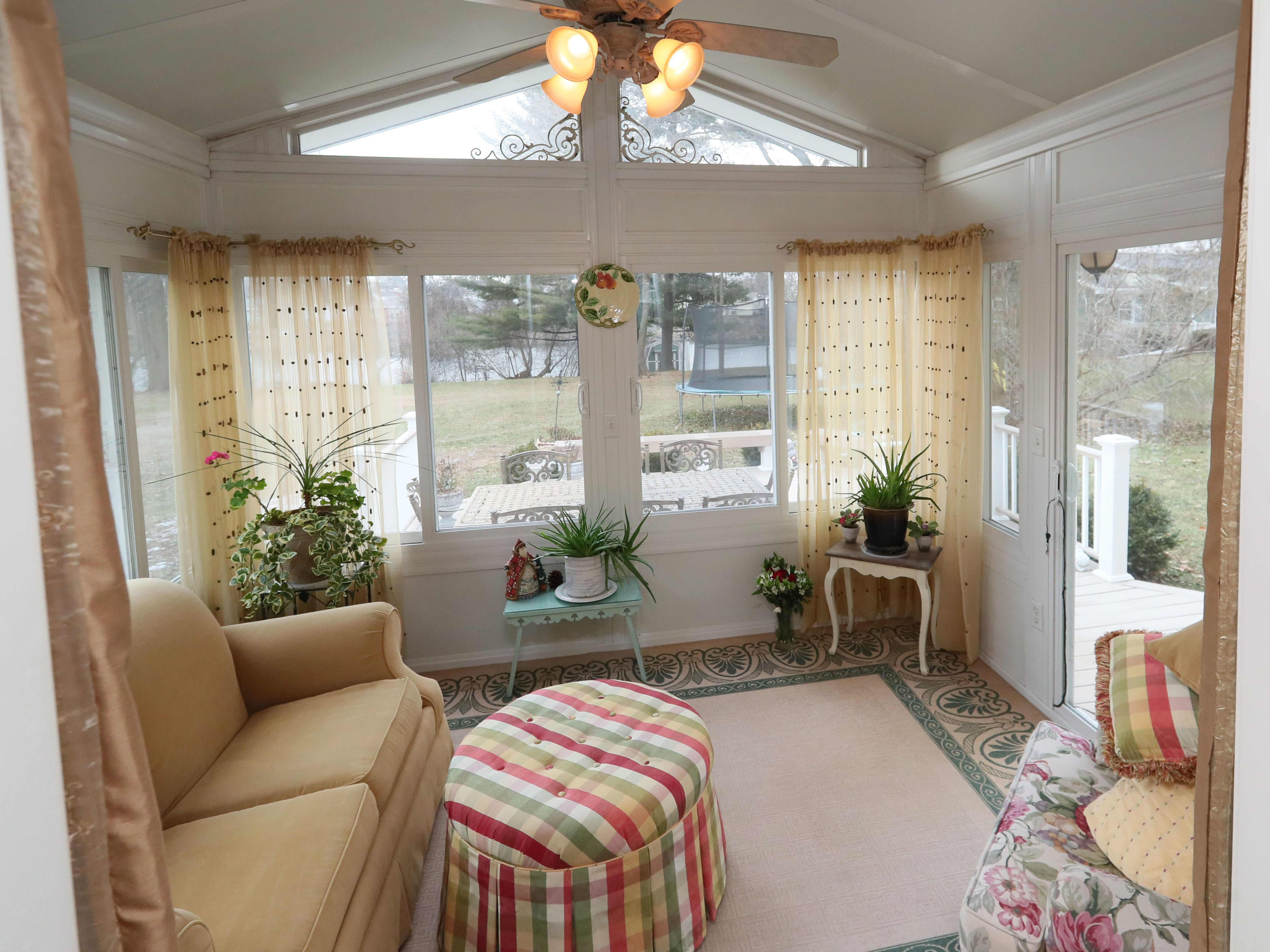 This four-season sunroom room sits off the kitchen.