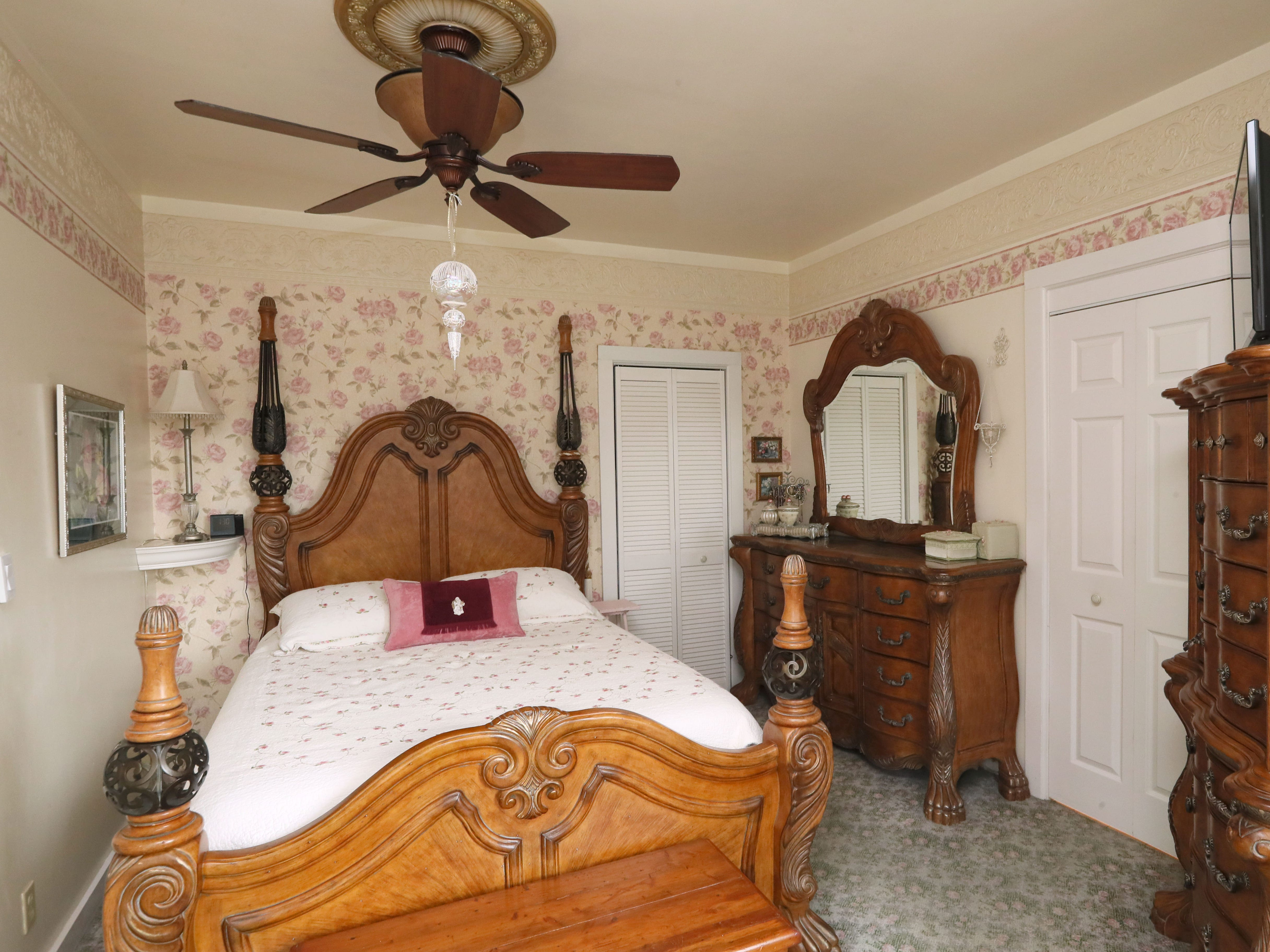 The master bedroom, like many rooms, features wallpaper.