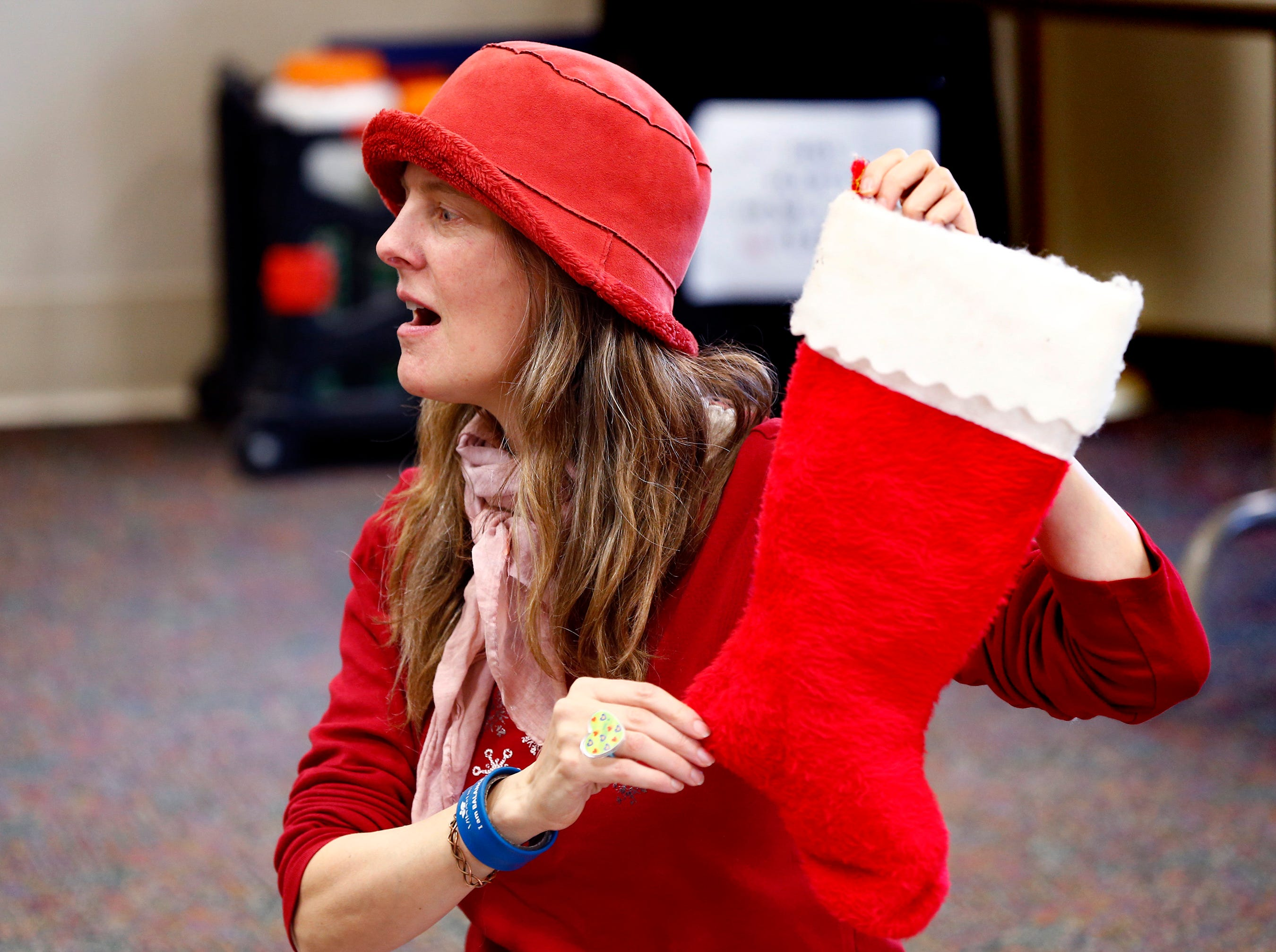 Julie Thompson leads a counting rhyme during Miss Julie's Music Fun Christmas Music Party at the Germantown Community Library on Dec. 18.