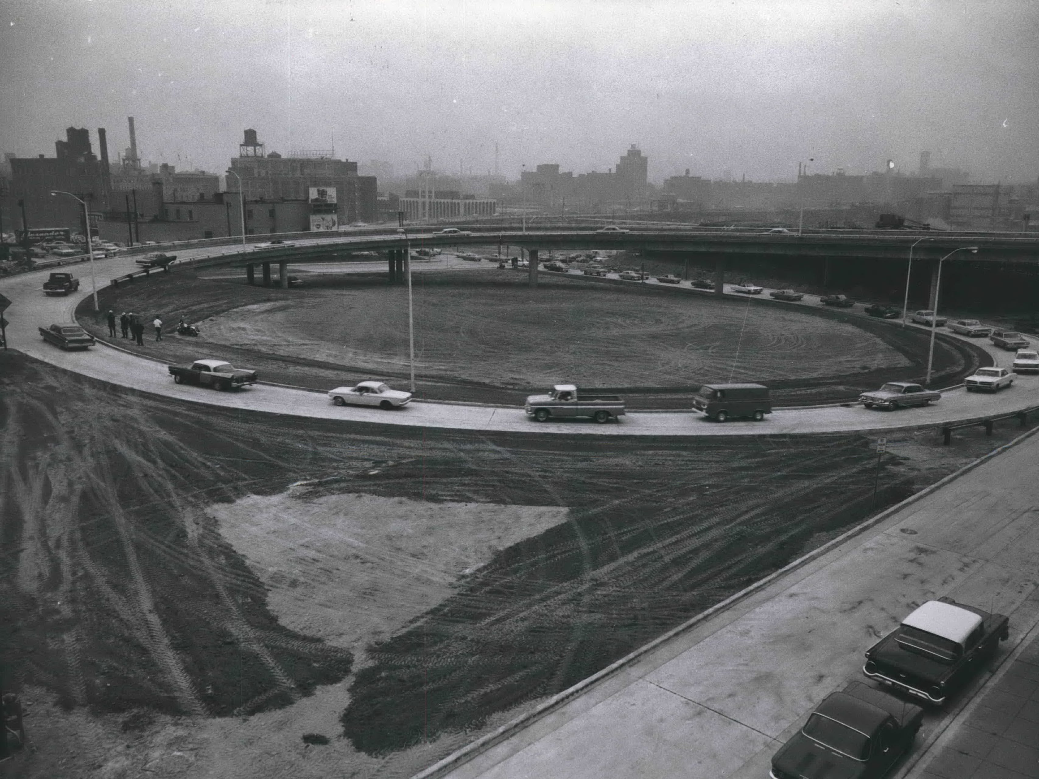 Cars get on the East-West Freeway via the new ramps at N. Seventh and Eighth streets at the still-under-construction Central Interchange in 1966.