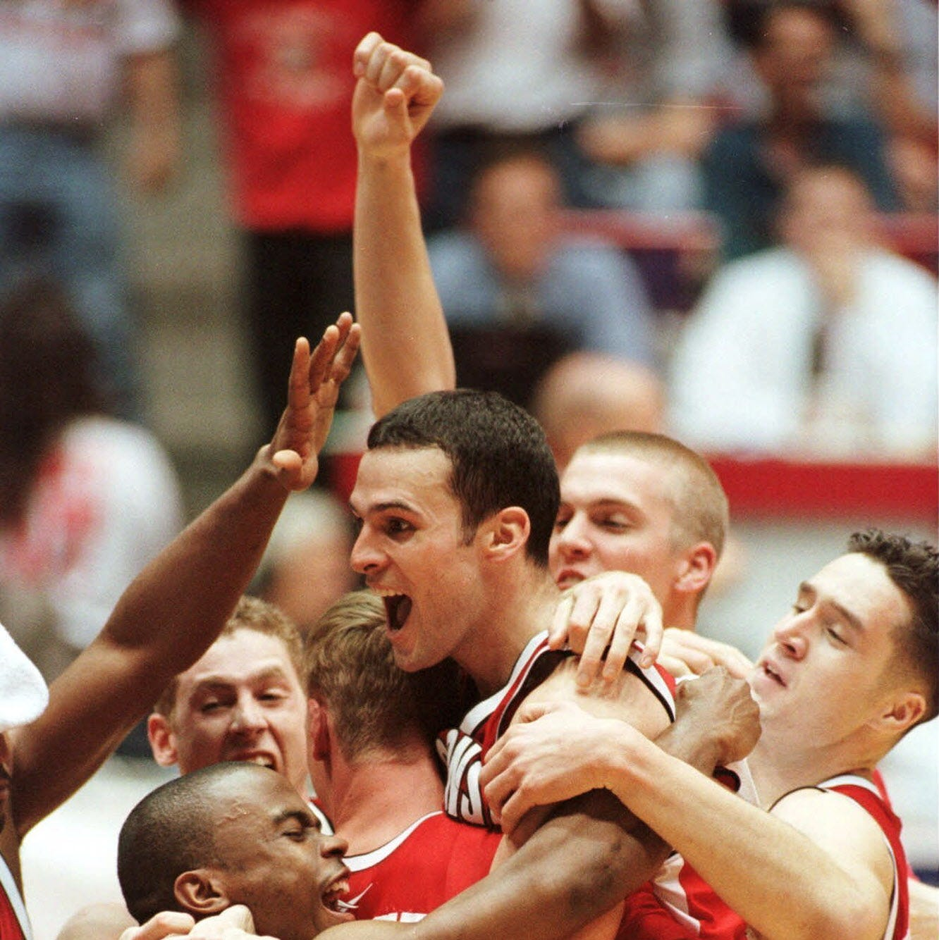 Wisconsin's Mike Kelley, center, celebrates with...