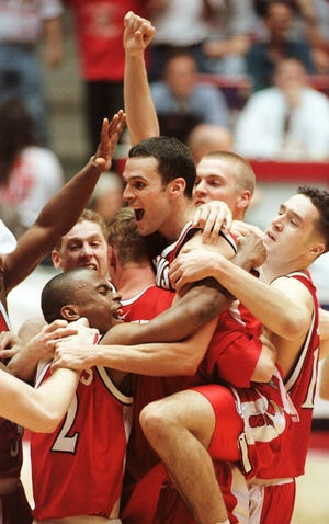 Wisconsin's Mike Kelley, center, celebrates with teammates after beating Purdue, 64-60, in the NCAA West regional Final on March 25, 2000.