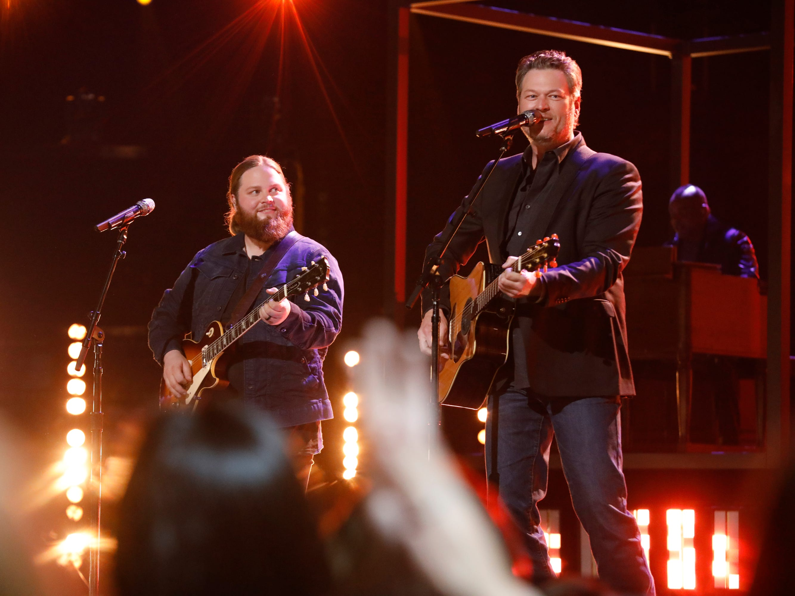"""Chris Kroeze looks on at his coach Blake Shelton during """"The Voice"""" finals Dec. 17, as the two sang a duet of Delbert McClinton's """"Two More Bottles of Wine."""""""