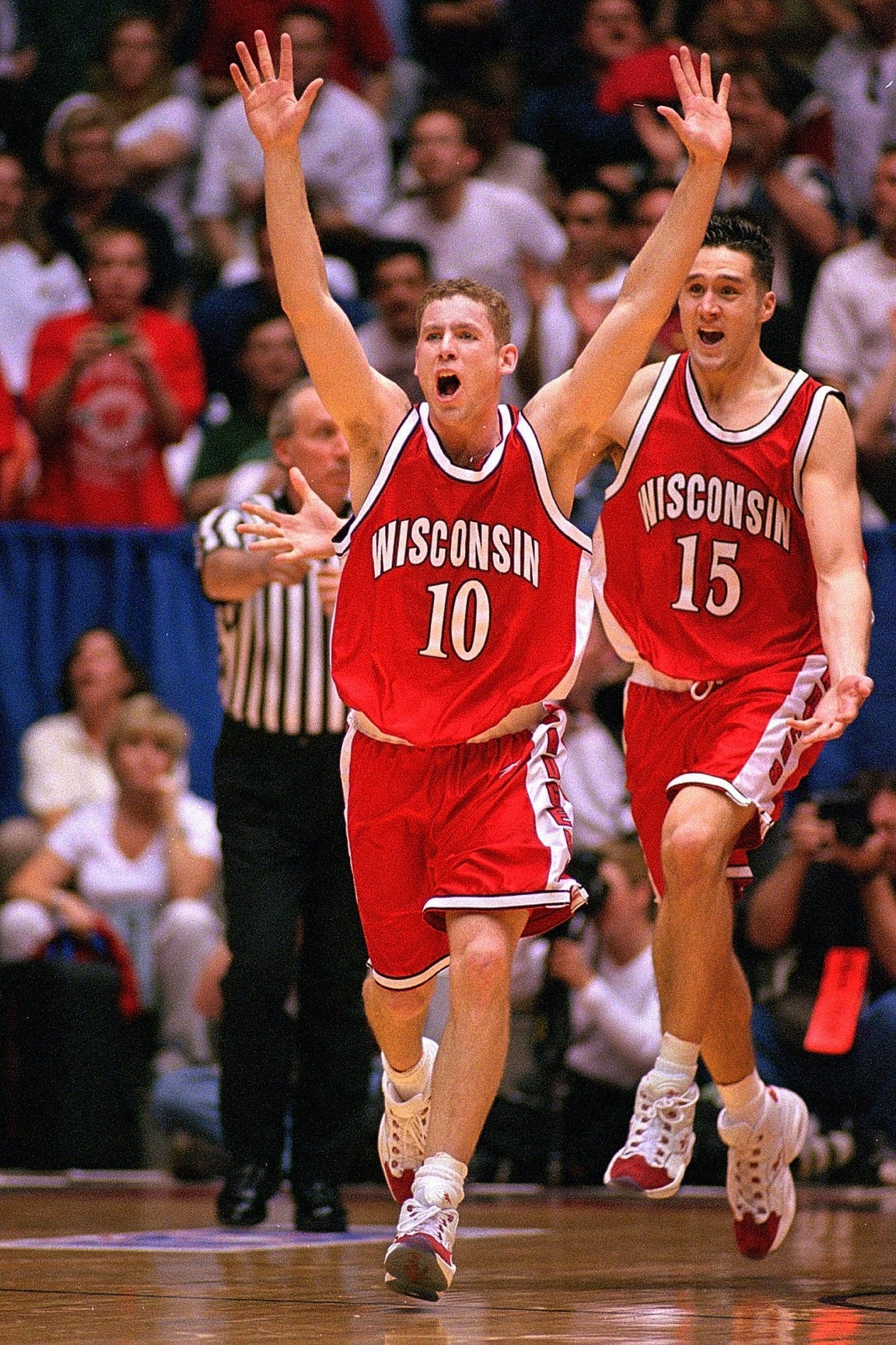 Jon Bryant (#10) and Andy Kowske (#15) celebrate Wisconsin's 64-60 victory over Purdue.