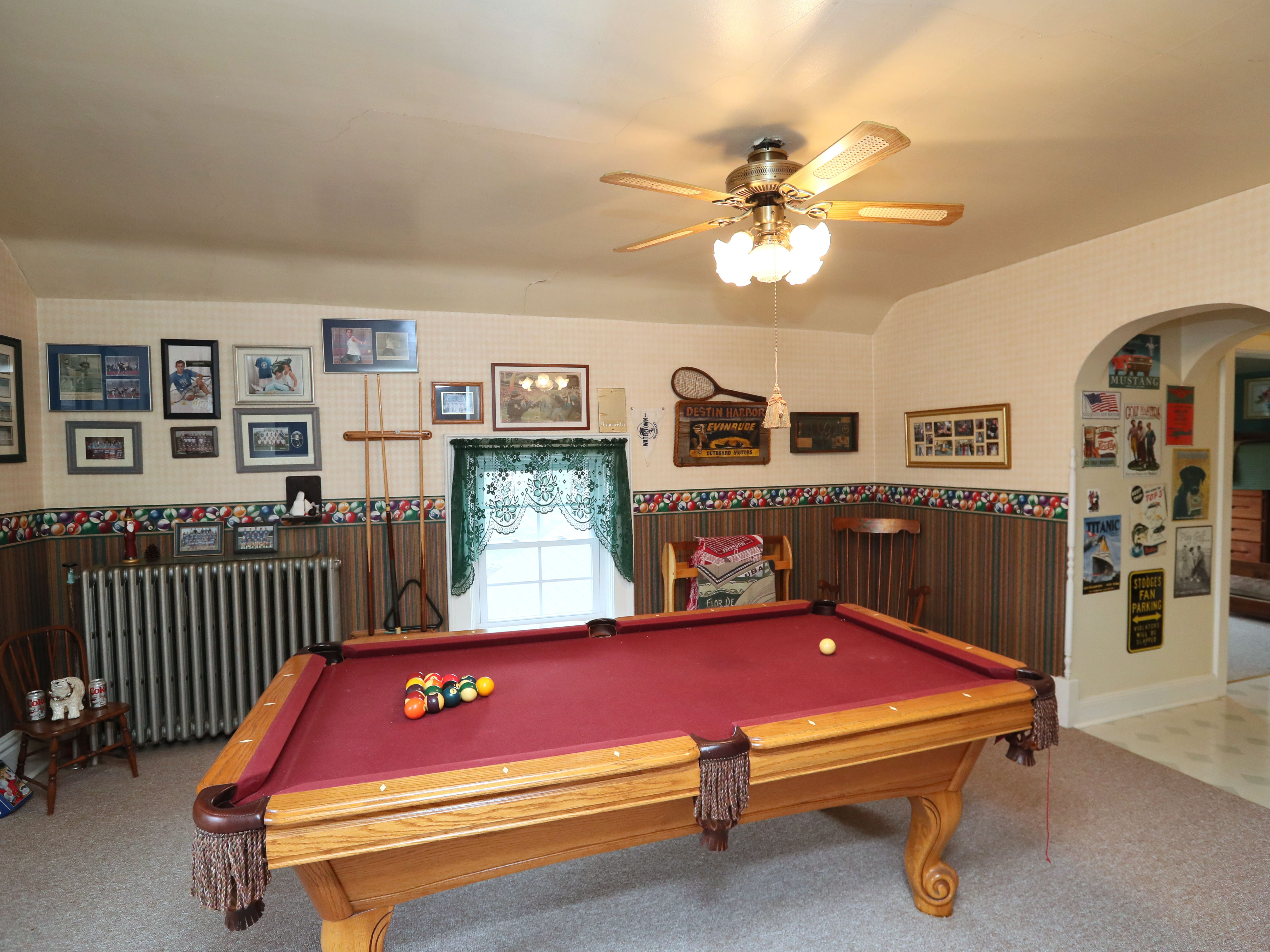 The second-floor game room has a pool table.