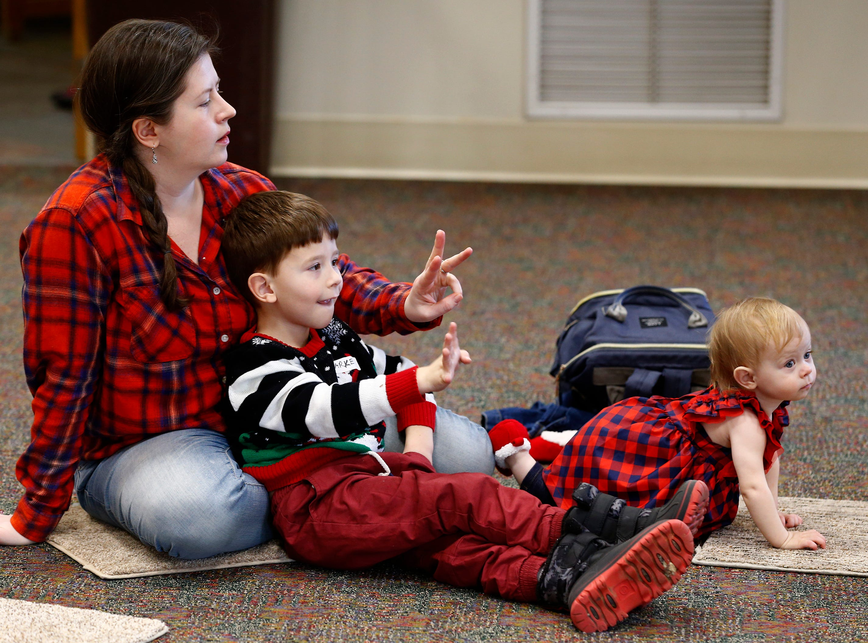 Molly, Clarke and Clara Tremblay count along during Miss Julie's Music Fun Christmas Music Party at the Germantown Community Library on Dec. 18.