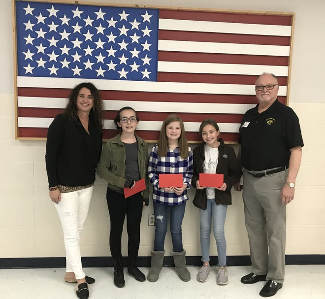 """The Pinkston Middle School sixth-grade winners of the 2018-2019 Elks Americanism Essay Contest were recently recognized at an awards ceremony at the school. Over 270 essays were submitted answering the question, """"What Makes You Proud of America?"""" The top three winners received a check for $100 each and their essays will be forwarded for state and national judging. Shown the photo are (from left) Vonya Schaufler, sixth grade science teacher and Elks Americanism chair; essay winners Emerson Walls, Rylee Crecelius, Ella Hilvert; and Wayne Markham, Elks president."""
