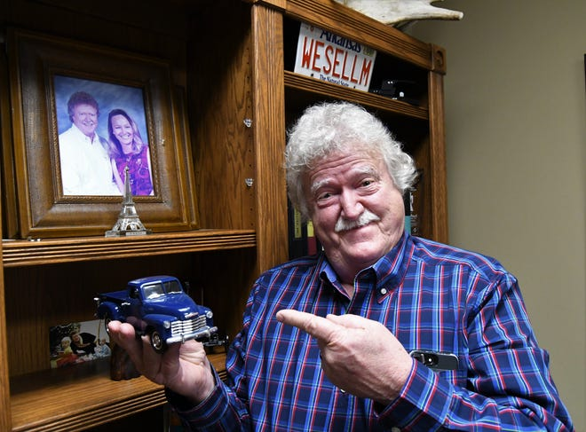 Larry Black shows off a toy model of a 1949 Chevrolet pickup on display in his office. After 31 years in the real estate business, Black in retiring at the end of the year to focus on restoring antique cars and tending to his ranch's cattle herd.