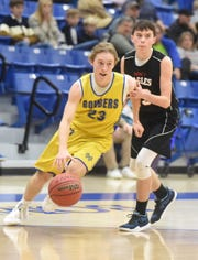 Mountain Home's Satch Harris (23) dribbles toward the hoop Monday night against Mountain Home Christian Academy.