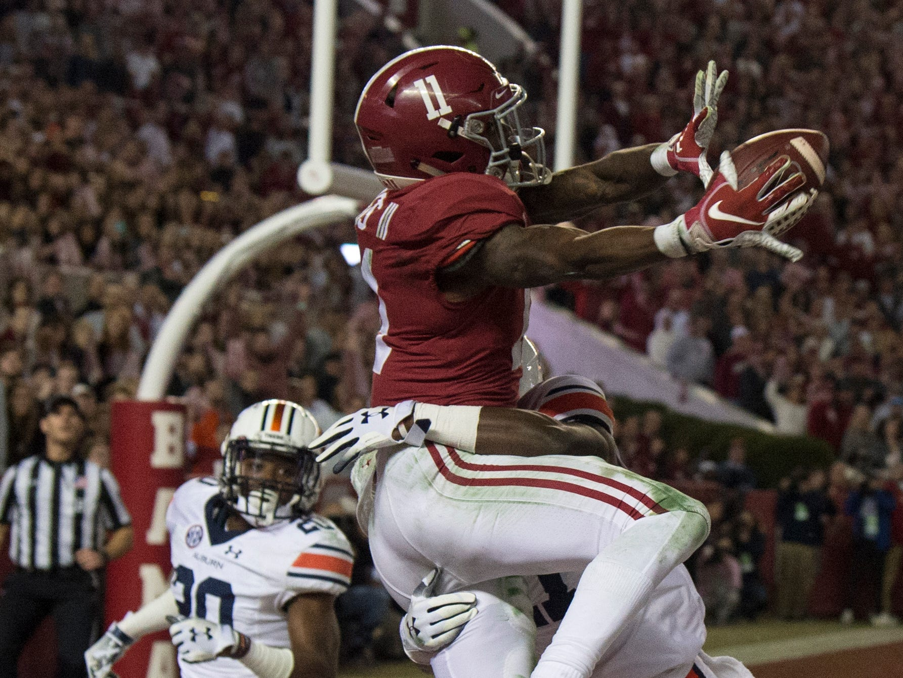Alabama wide receiver Henry Ruggs, III, (11) catches a touchdown pass in the end zone during the Iron Bowl at Bryant-Denny Stadium in Tuscaloosa, Ala., on Saturday, Nov. 24, 2018. Alabama defeated Auburn 52-21.
