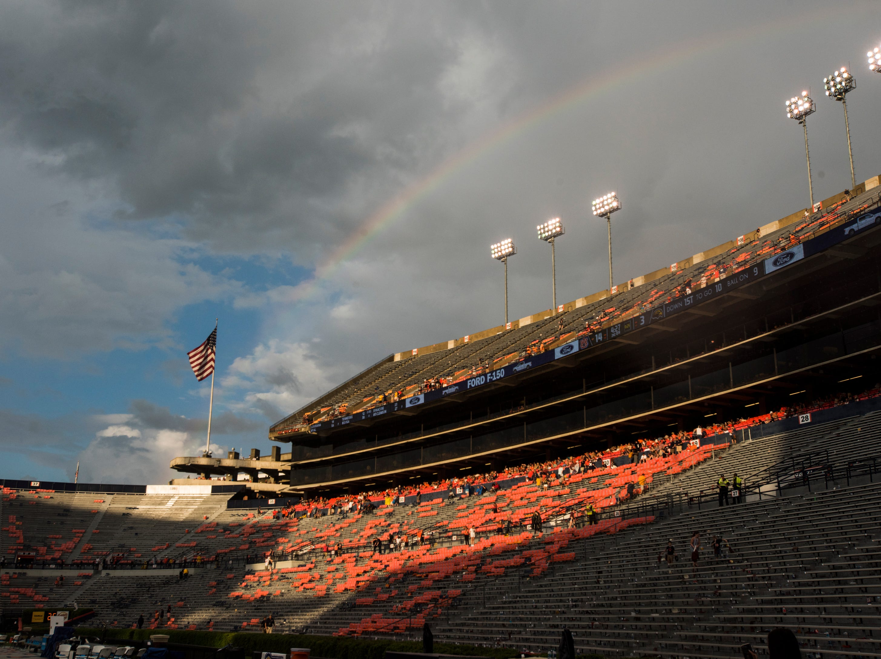 The sun comes out and a rainbow is see as fans and players wait for a weather delay at Jordan-Hare Stadium in Auburn, Ala., on Saturday, Sept. 29, 2018. Auburn leads Southern Miss 14-3, the game went into a weather delay with 4:27 left in the second quarter.