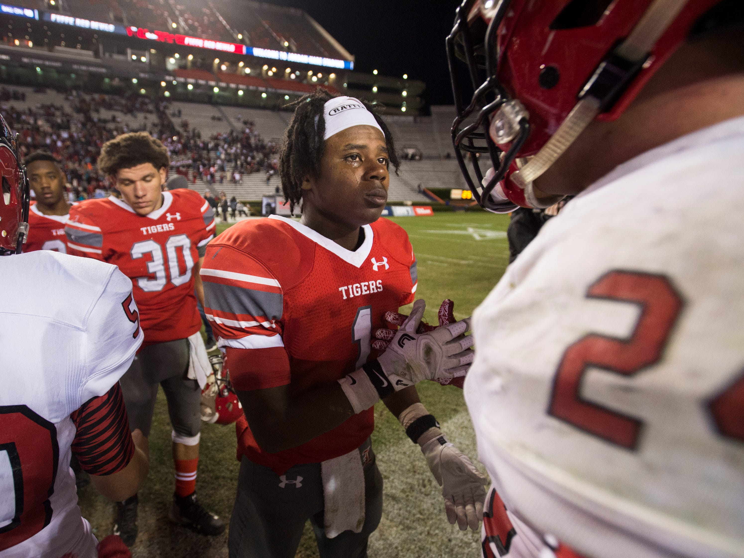 Luverne's Edward Thomas (1) shakes hands with Fyffe's Payton Anderson (24) after the Class 2A state championship at Jordan-Hare Stadium in Auburn, Ala., on Friday, Dec. 7, 2018. Fyffe defeated Luverne 21-19.