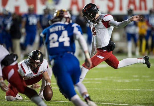 Alabama all-star Hoover's Will Reichard (8) kicks an extra point during the Alabama-Mississippi all-star game at Cramton Bowl in Montgomery, Ala., on Monday, Dec. 17, 2018.