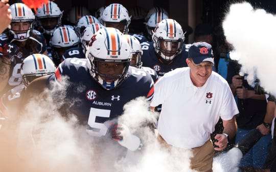 Auburn head coach Gus Malzahn leads his team out before taking on LSU at Jordan-Hare Stadium in Auburn, Ala., on Saturday, Sept. 15, 2018.