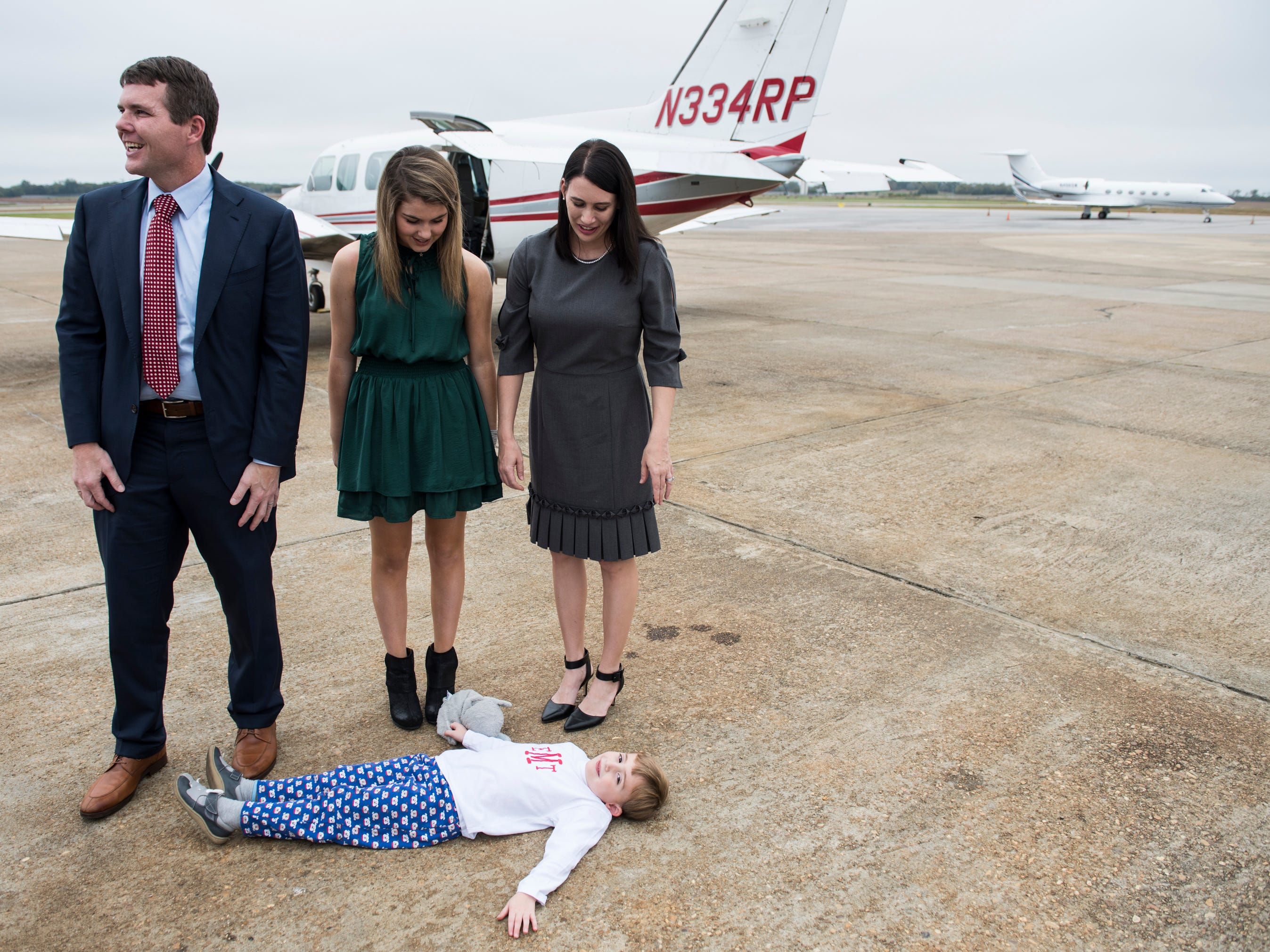 Democratic gubernatorial nominee Walt Maddox, from left, arrives with his daughter, Taylor, wife, Stephanie, and son, Eli, 5, during a final campaign stop at Montgomery Airport in Montgomery, Ala., on Monday, Nov. 5, 2018.