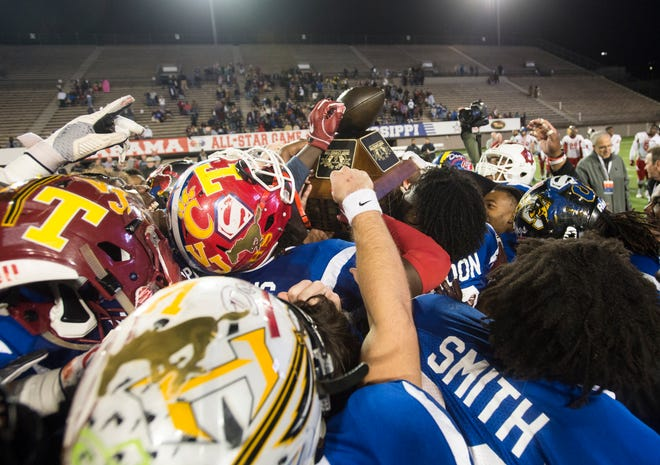 Mississippi all-star team celebrates after winning the Alabama-Mississippi all-star game at Cramton Bowl in Montgomery, Ala., on Monday, Dec. 17, 2018.