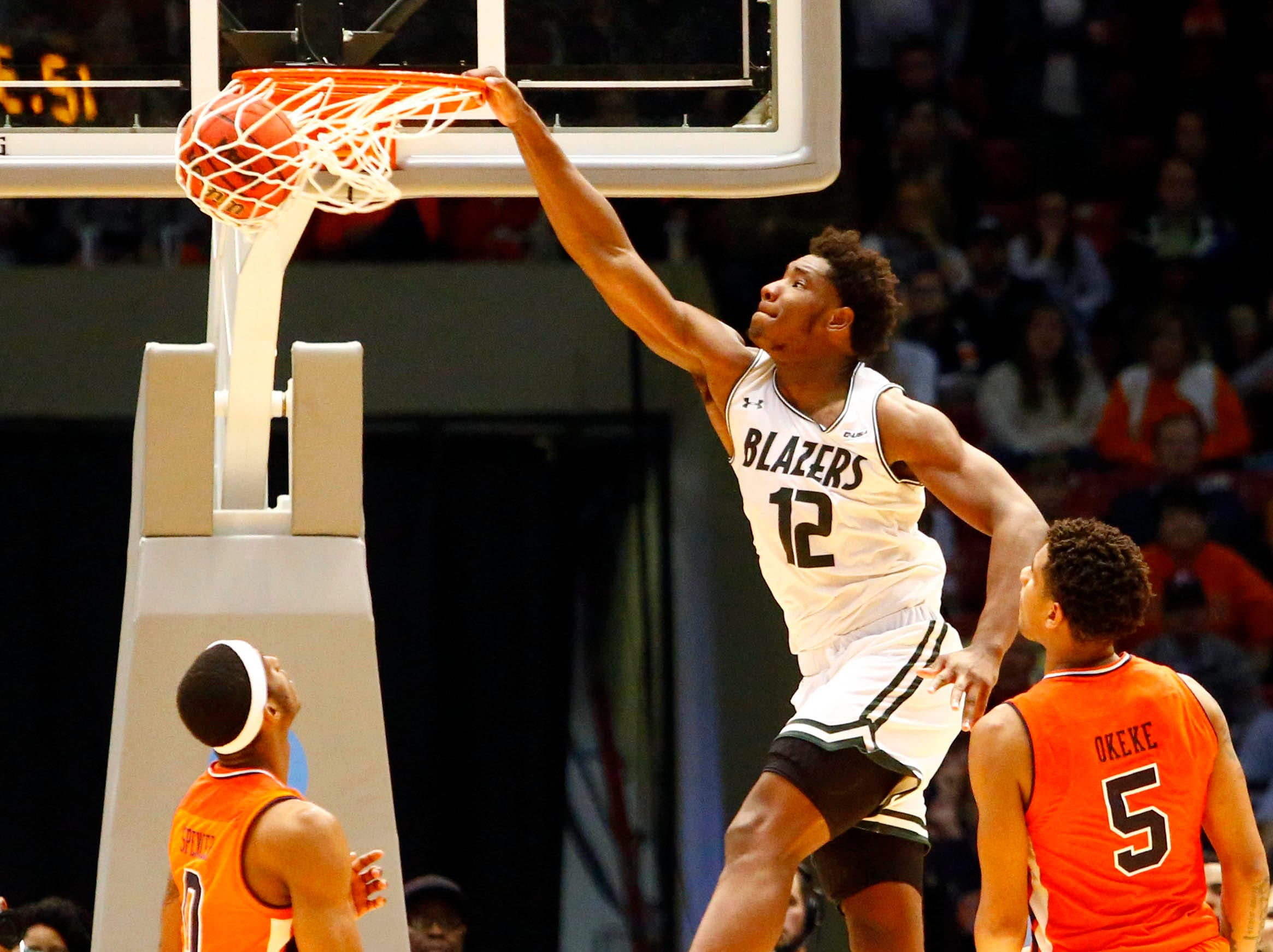 Dec 15, 2018; Birmingham, AL, USA; UAB Blazers forward Will Butler (12) slam dunks the ball during the second half of an NCAA basketball game against the Auburn Tigers at Legacy Arena. Mandatory Credit: Butch Dill-USA TODAY Sports