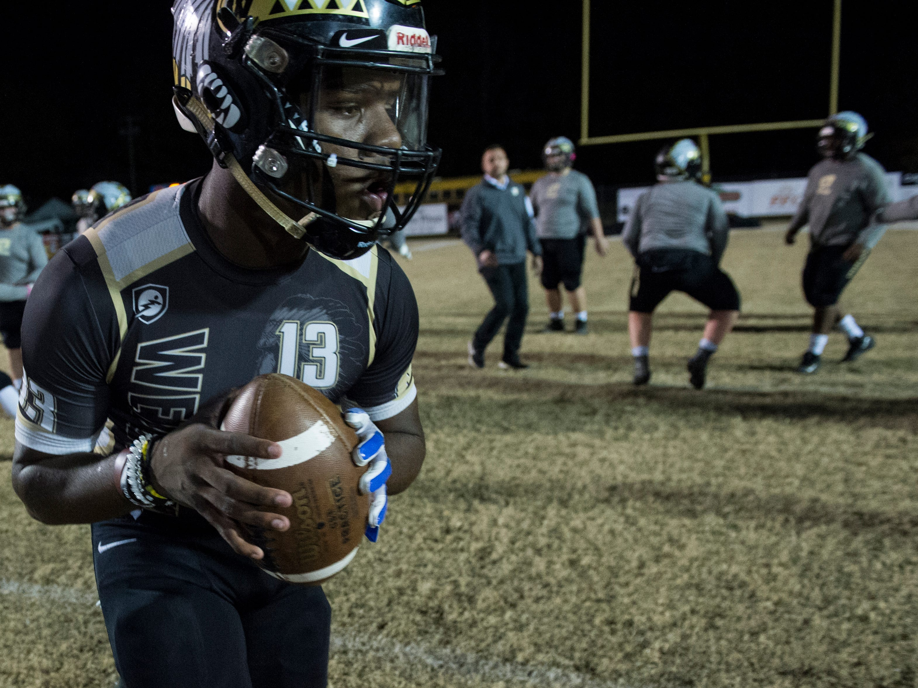 Wetumpka's Tyquan Rawls runs a play during warm ups at Hohenberg Field in Wetumpka, Ala., on Friday, Nov. 30, 2018. Wetumpka leads Saraland 14-8 at halftime.