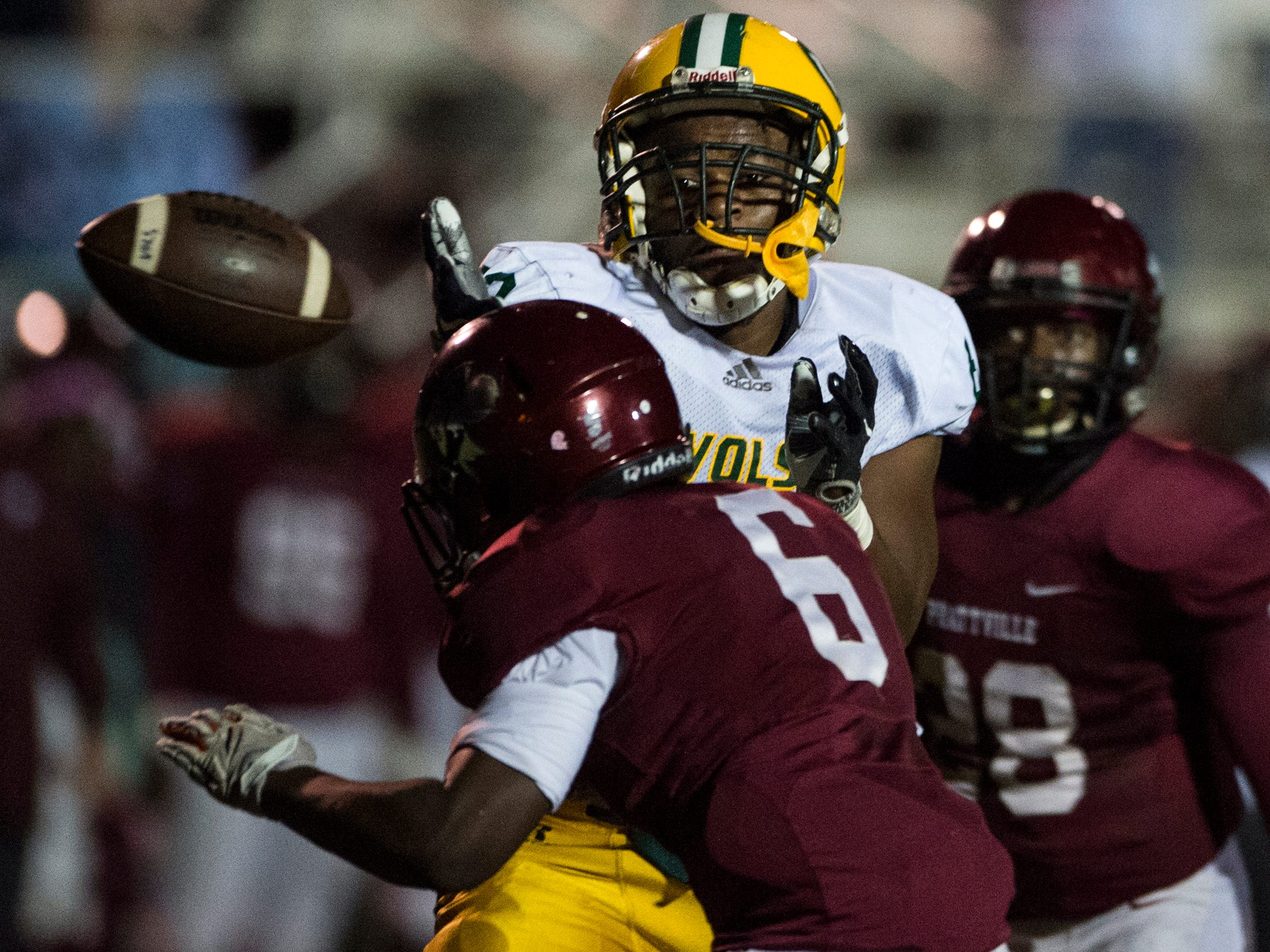 Jeff Davis' Demarcus Jiles (82) drops the ball as he is hit by Prattville's Winter White (6) at Stanley- Jensen Stadium in Montgomery, Ala., on Friday, Oct. 12, 2018. Jeff Davis leads Prattville 19-13 at halftime.