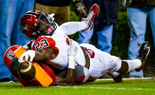 Central-Phenix City's Joseph McKay reaches for but misses a touchdown as he is forced out of bounds by Thompson's Elijah Clayton during the AHSAA Class 7A State Championship Football Game at Jordan Hare Stadium in Auburn, Ala., on Wednesday evening December 5, 2018.
