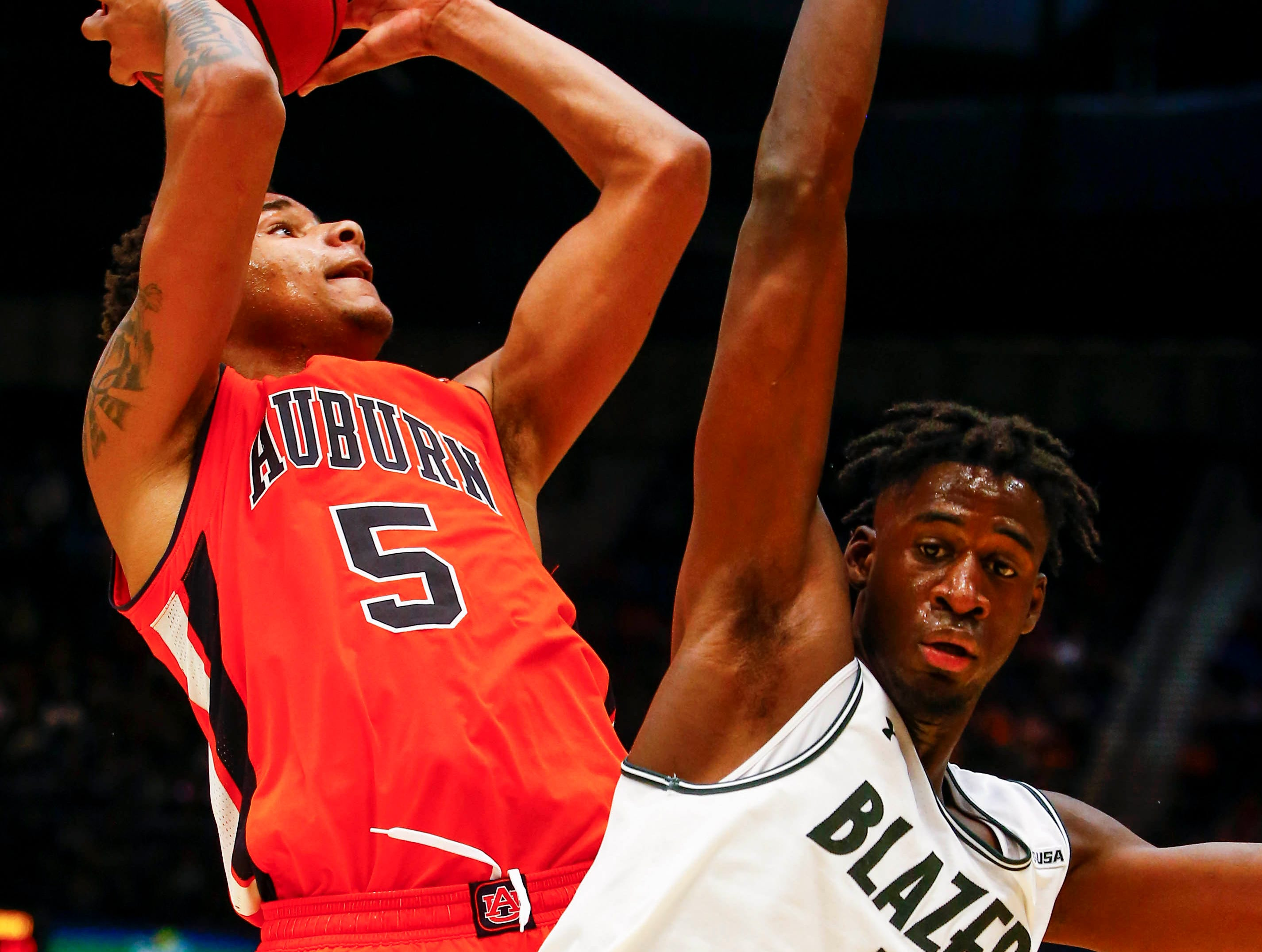 Dec 15, 2018; Birmingham, AL, USA; Auburn Tigers forward Chuma Okeke (5) is fouled by UAB Blazers forward Makhtar Gueye (5) as he goes up for a shot during the second half of an NCAA basketball game at Legacy Arena. Mandatory Credit: Butch Dill-USA TODAY Sports