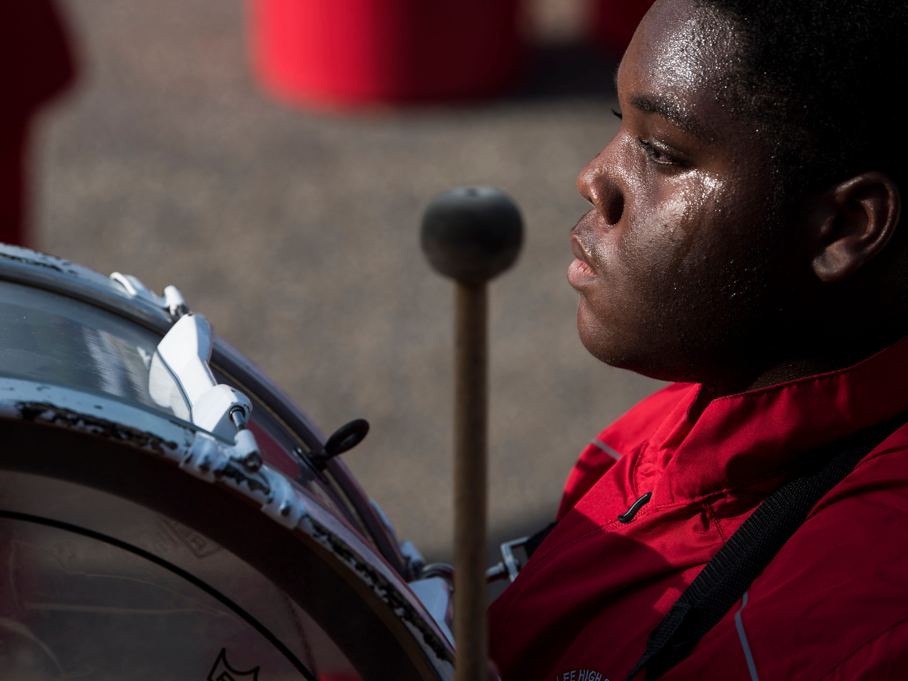 The Lee high school drum line performs during he ground breaking ceremony for the new indoor pool at the Cleveland Ave. YMCA in Montgomery, Ala., on Thursday, Aug. 16, 2018.