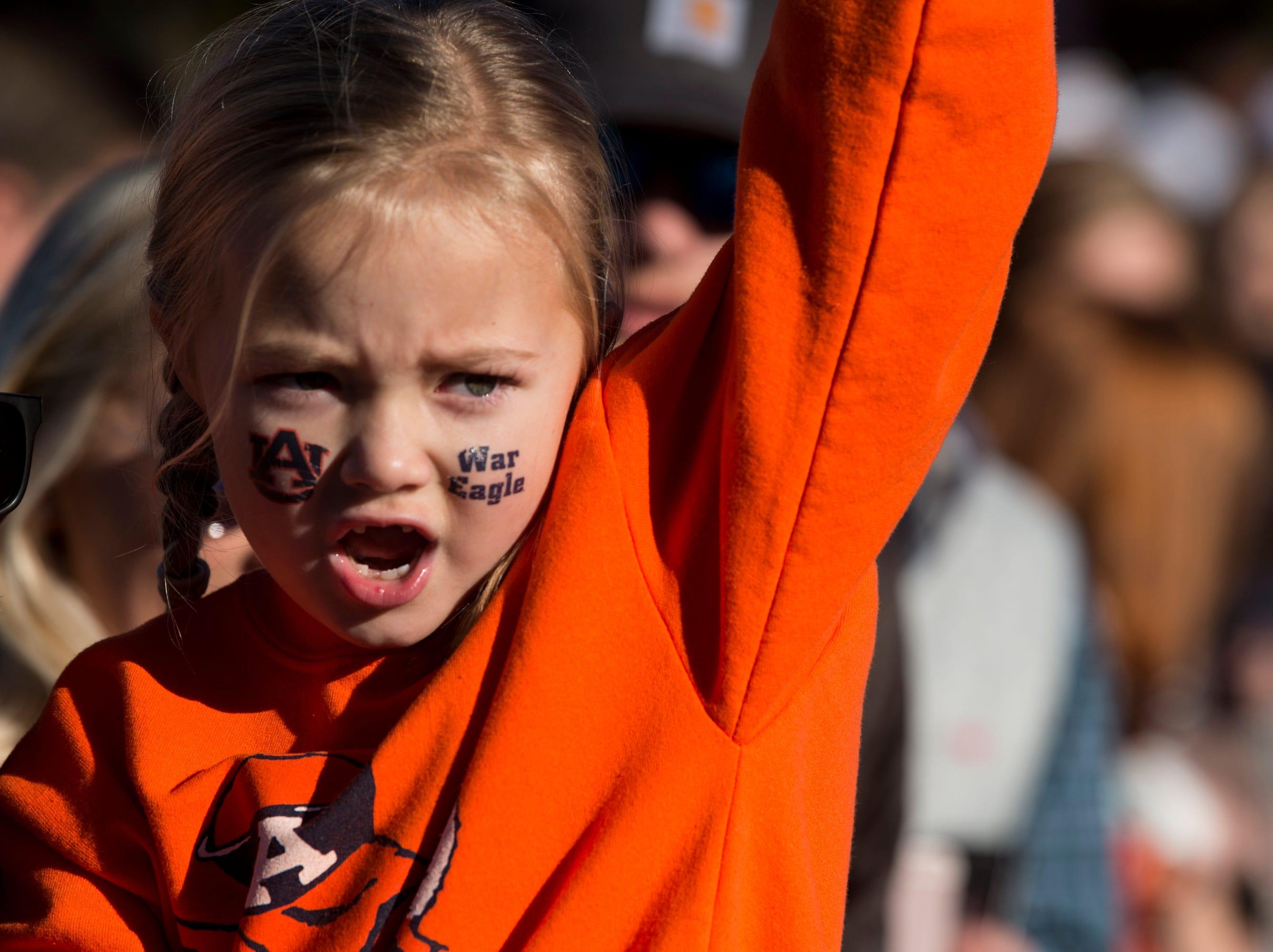 "Lakyn Evans, 5, chants ""War Eagle"" during the Tiger Walk outside Jordan-Hare Stadium on Saturday, Nov. 3, 2018."