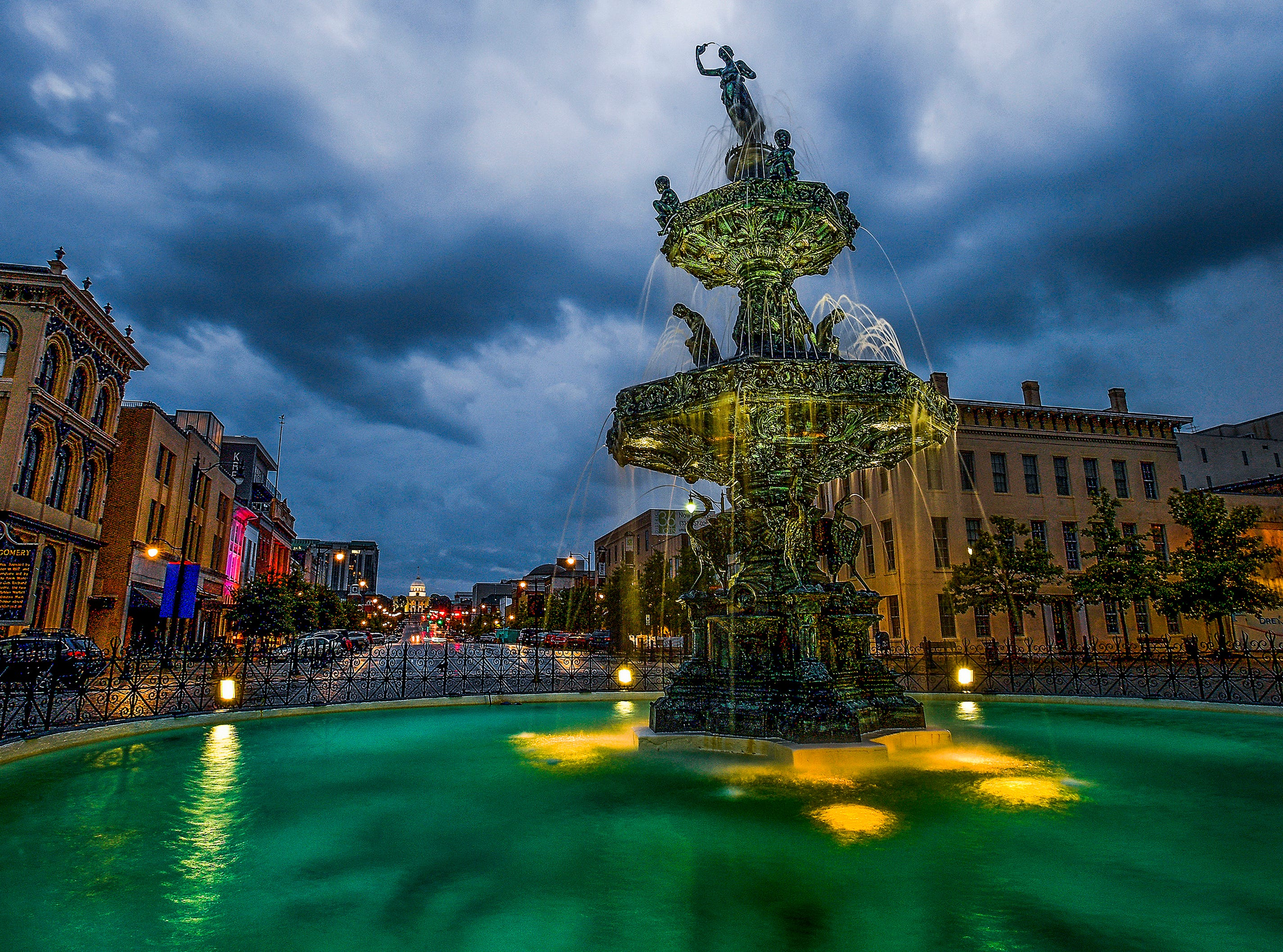 Storm clouds roll in over the Court Square Fountain and Dexter Avenue on Tuesday evening September 4, 2018.