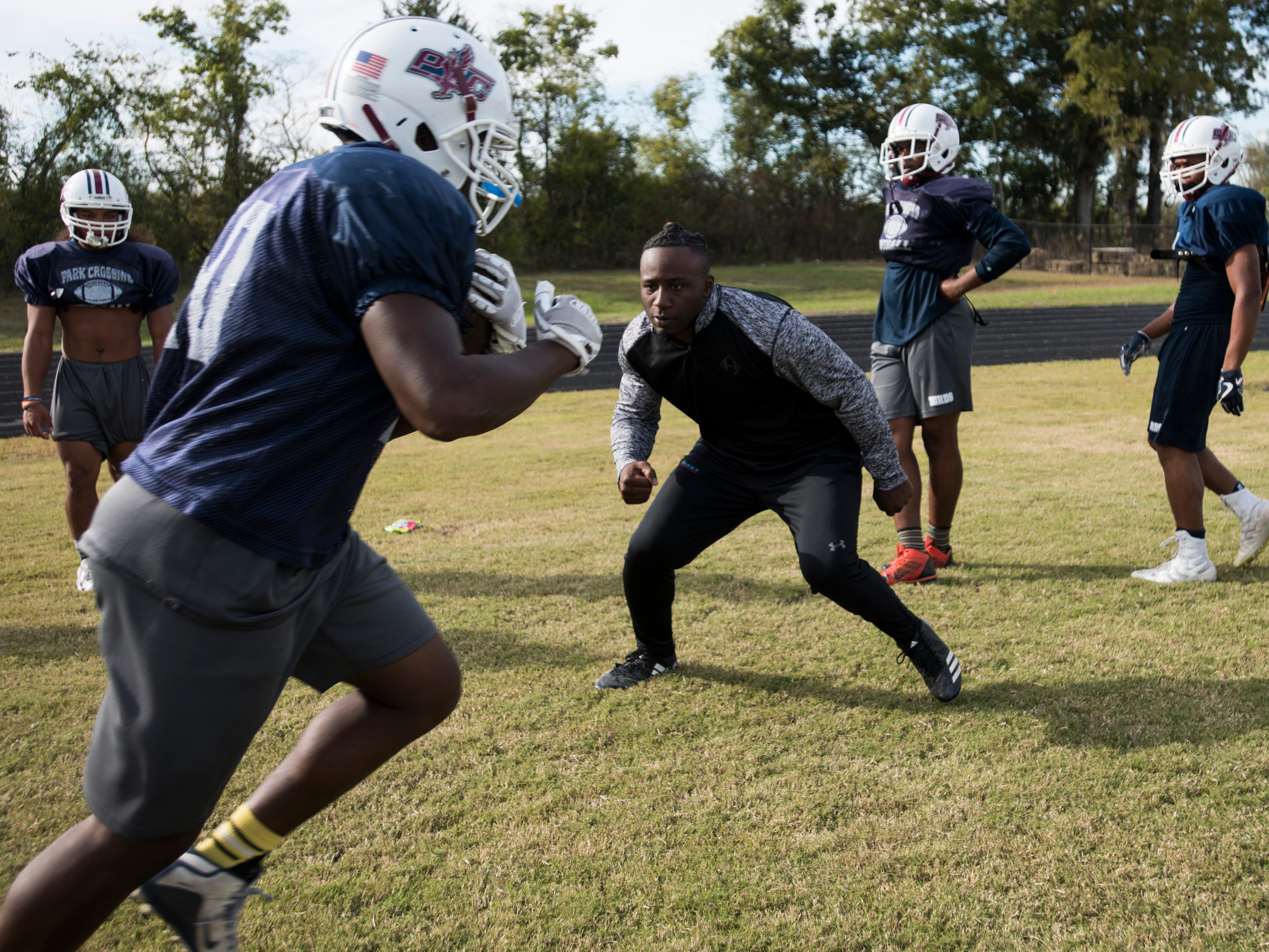 Kamryn Pettway, former Auburn running back, runs drills as he coaches at Park Crossing High School in Montgomery, Ala., on Wednesday, Oct. 24, 2018.