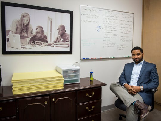 Justin Hampton poses for a portrait in his office at Montgomery Education Foundation in Montgomery, Ala., on Tuesday, Dec. 18, 2018.