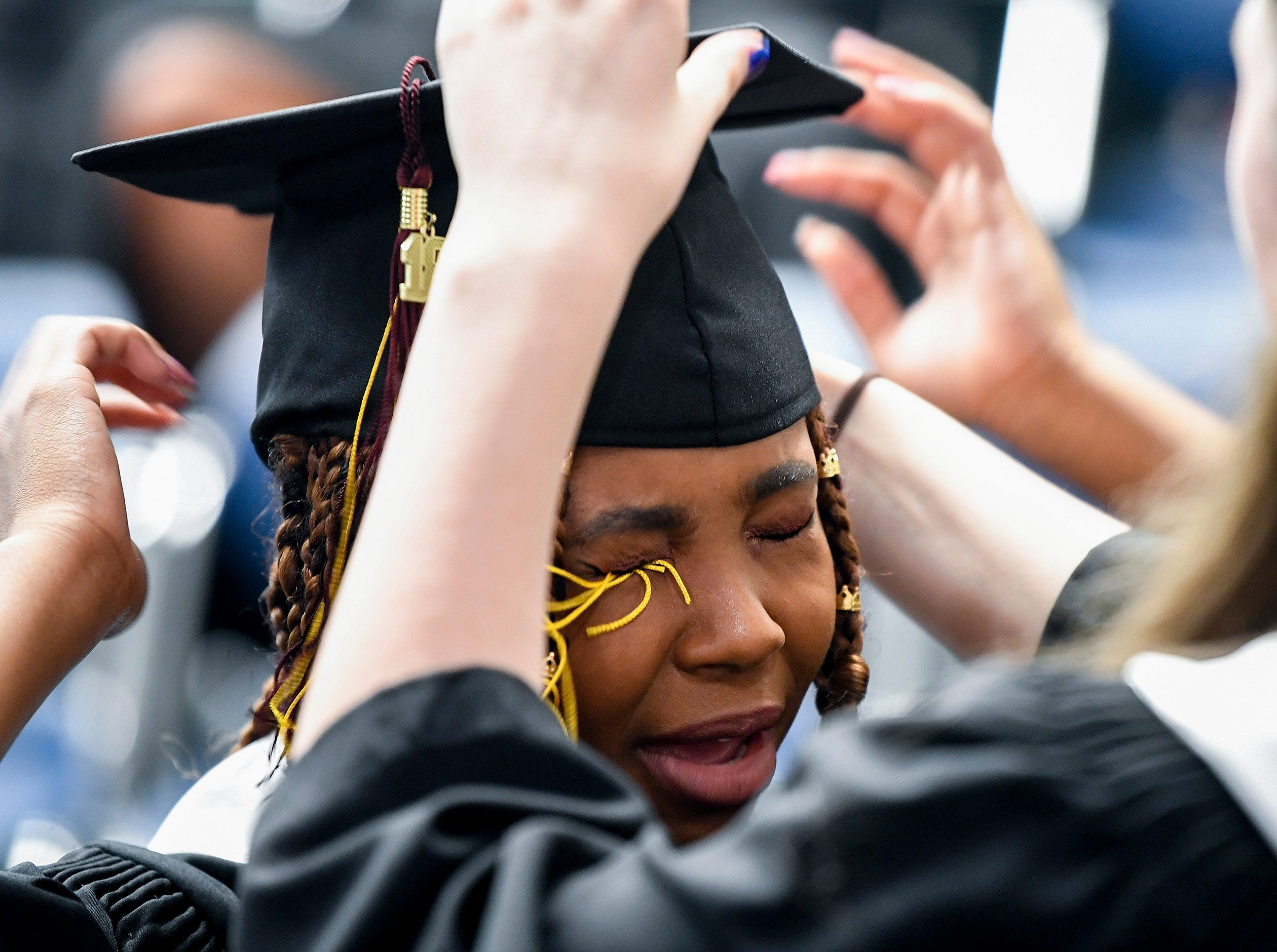 LAMP Magnet High School graduate Tymia Ballard gets her graduation tassel caught in her eye during graduation at First Baptist Church in Montgomery, Ala. on Tuesday May 22, 2018