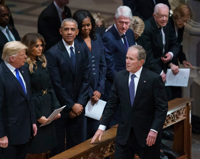 Former President George W. Bush, walks to his seat after greeting President Donald Trump, first lady Melania Trump, former President Barack Obama, Michelle Obama, former President Bill Clinton, former Secretary of State Hillary Clinton, former President Jimmy Carter, and Rosalynn Carter, as he arrives at the State Funeral of former President George H.W. Bush at the National Cathedral, Wednesday, Dec. 5, 2018, in Washington. (AP Photo/Carolyn Kaster)