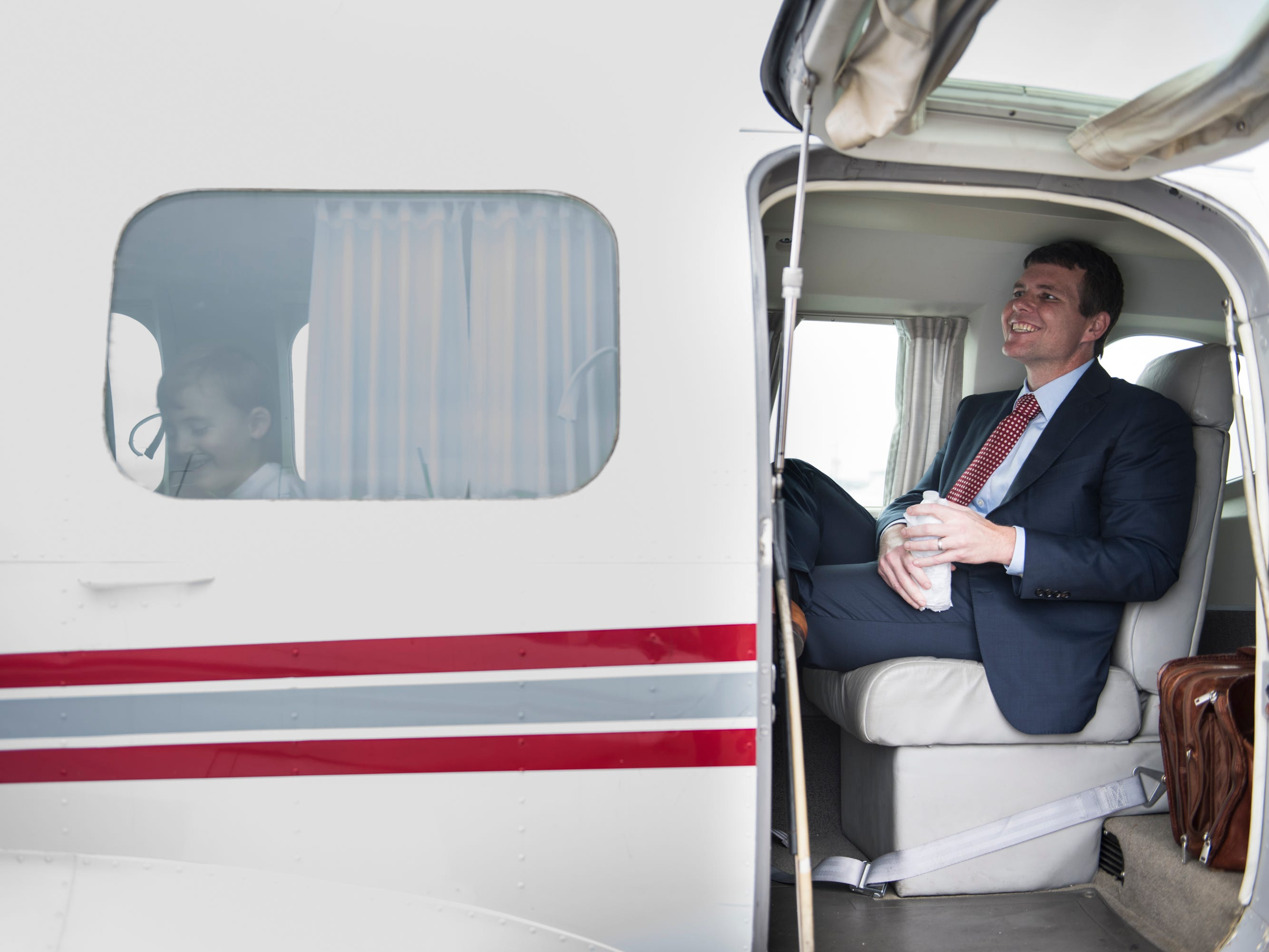 Democratic gubernatorial nominee Walt Maddox waits to takeoff after a final campaign stop at Montgomery Airport in Montgomery, Ala., on Monday, Nov. 5, 2018.