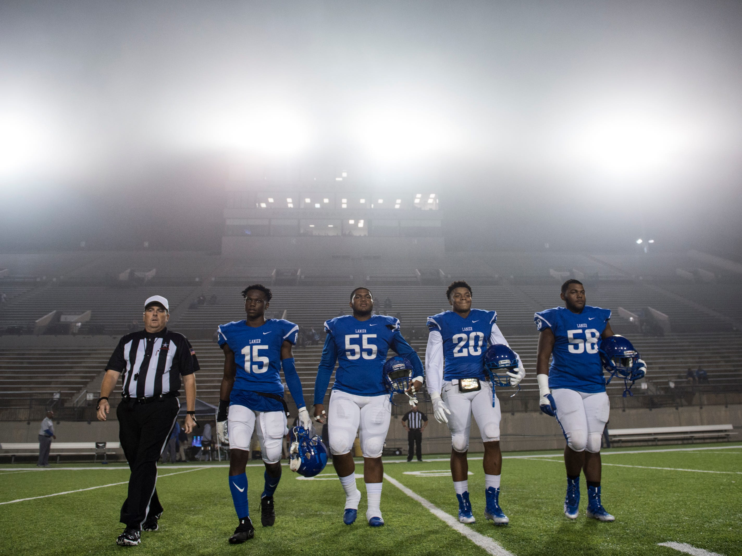 Lanier team captains walk to midfield for the coin toss during the first round of the Class 6A playoffs at Cramton Bowl in Montgomery, Ala., on Thursday, Nov. 8, 2018. Hillcrest leads Lanier 10-0 at halftime.