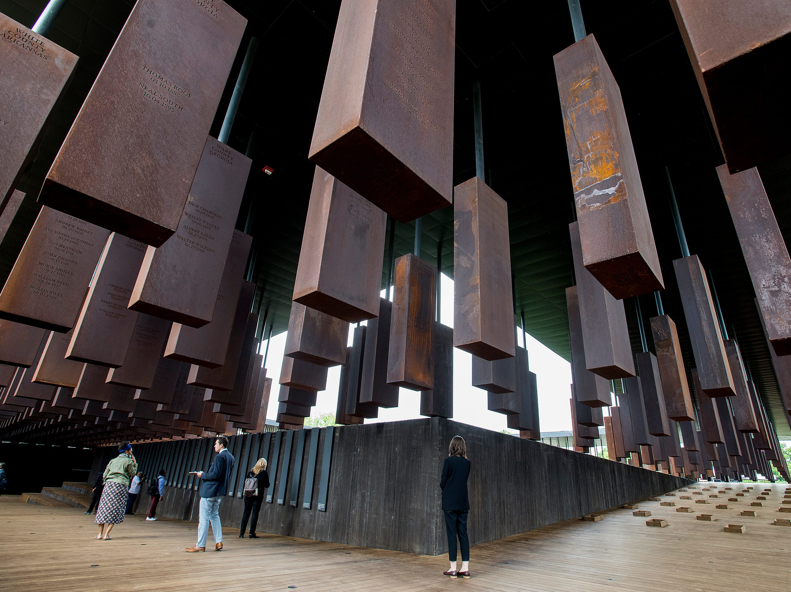 Obilisks with names of people lynched on them by county are displayed at the National Memorial for Peace and Justice in Montgomery, Ala. on Monday April 23, 2018.