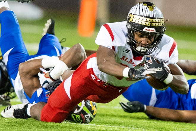 Alabama's Deangelo Jones of Wetumpka dives for yardage during the Alabama Mississippi All-Star Football game held at Cramton Bowl in Montgomery, Ala., on Monday December 17, 2018.