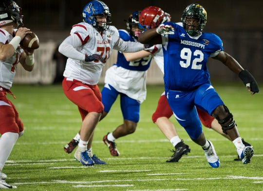 Mississippi all-star West Jones' Byron Young (92) fights through the line during the Alabama-Mississippi all-star game at Cramton Bowl in Montgomery, Ala., on Monday, Dec. 17, 2018.