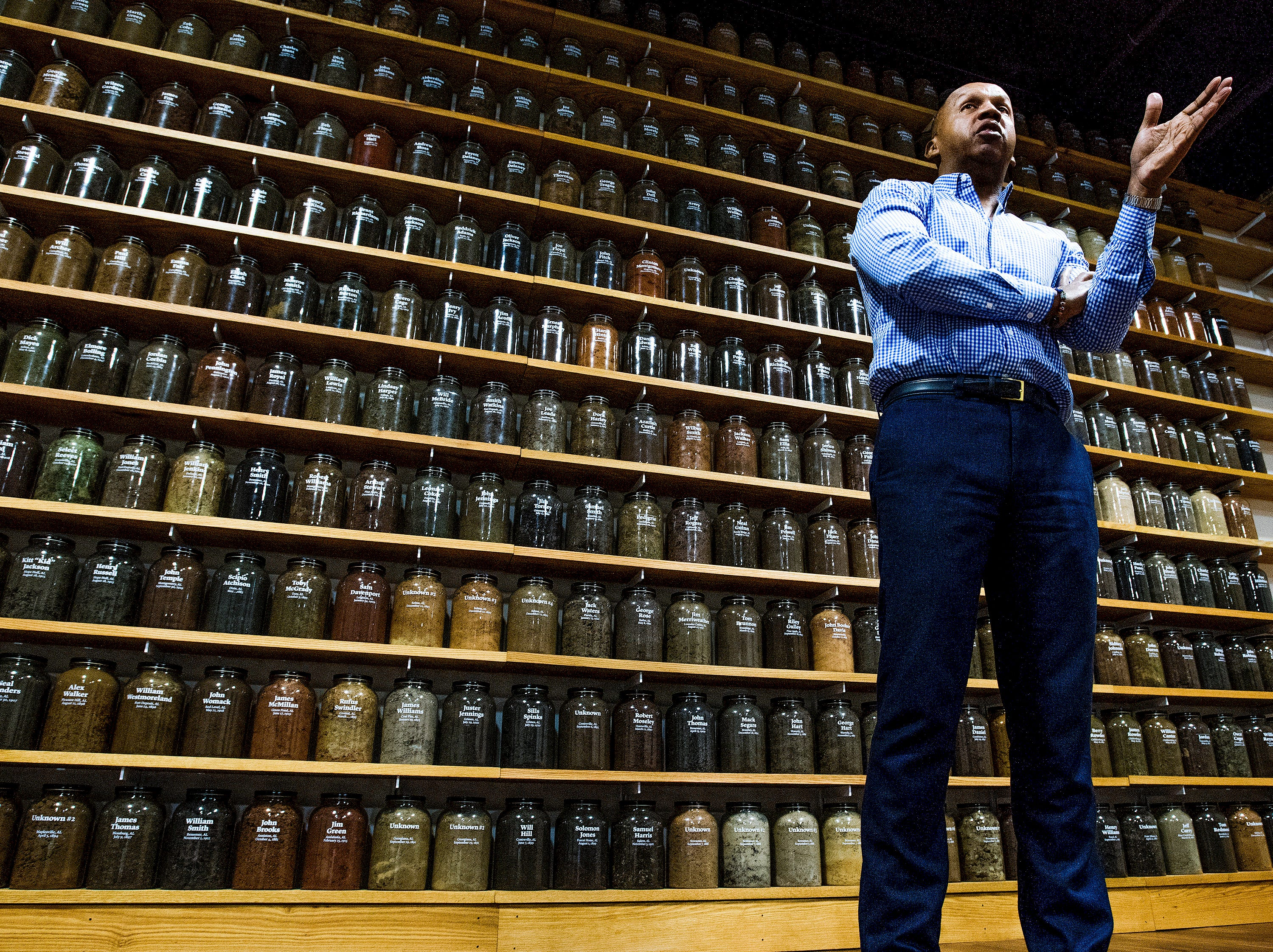 Bryan Stevenson, Executive Director of the Equal Justice Initiative, is shown standing before jars containing soil from the sites of confirmed lynchings in the state of Alabama at the EJI offices in Montgomery, Ala. on Friday April 13, 2018.