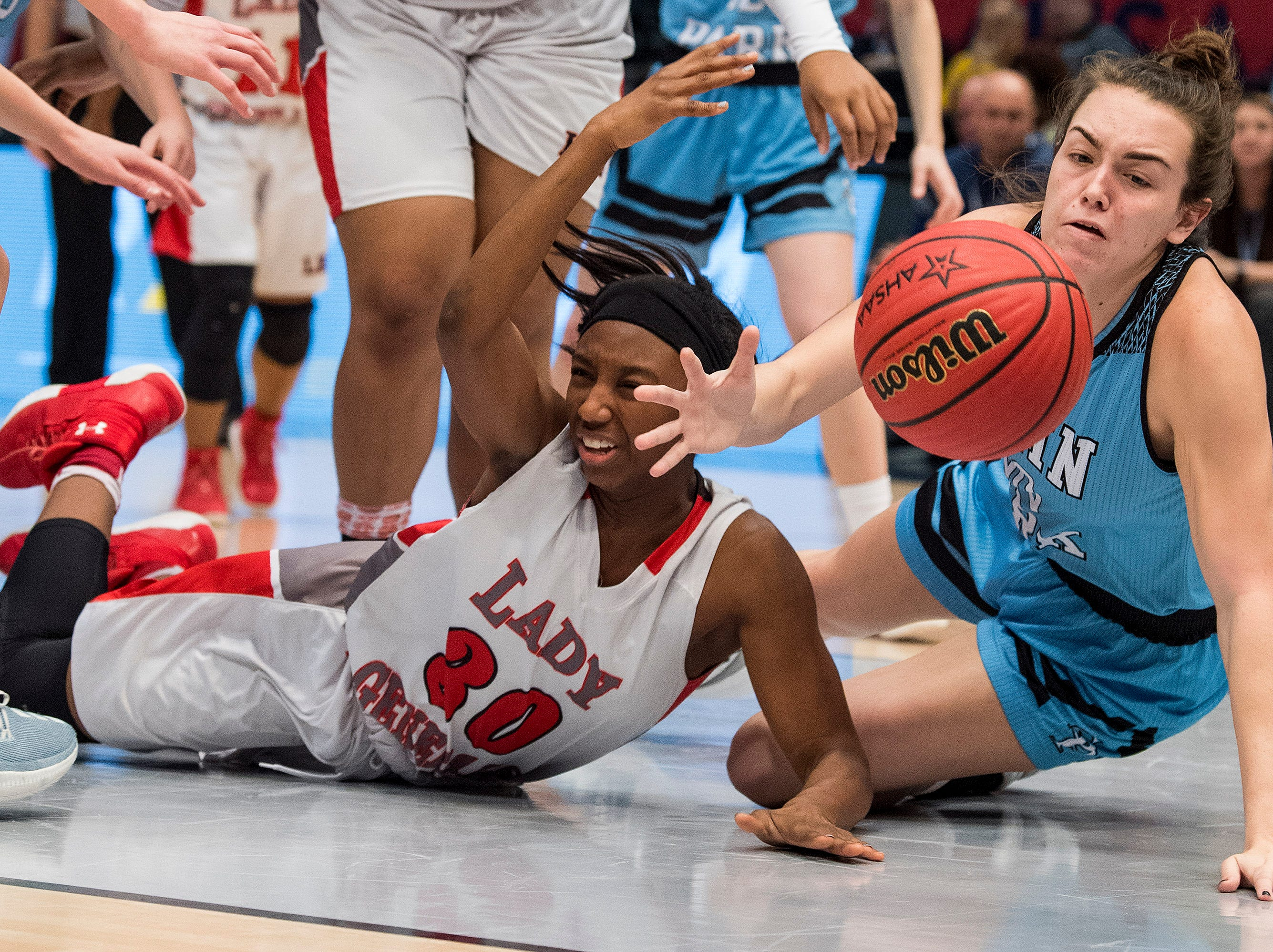 Lee's Dalayiah Crawford (30) and Spain Park's Barrett Herring go after a loose ball in their AHSAA State Semi-Final game at Legacy Arena in Birmingham, Ala. on Thursday March 1, 2018.