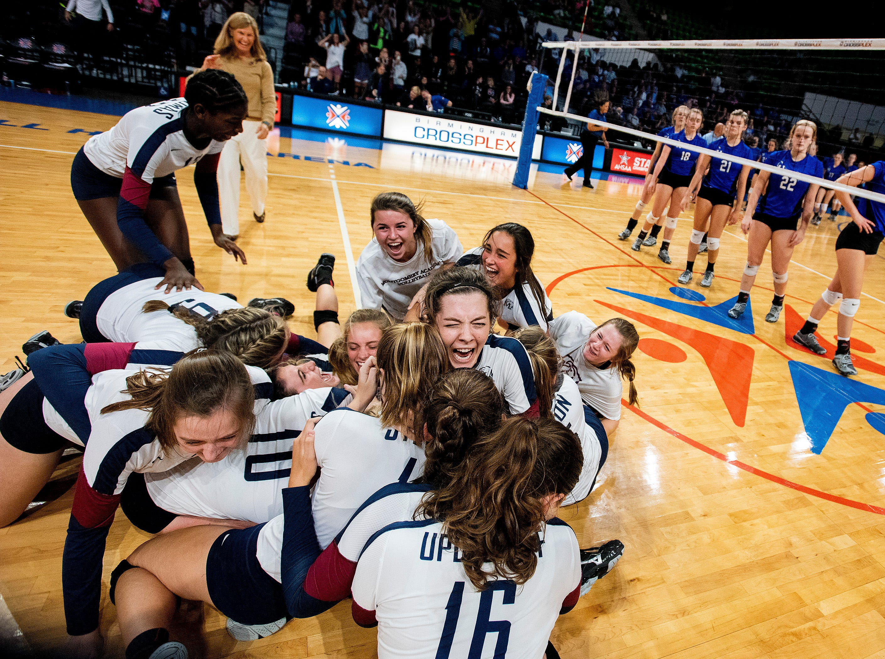 Montgomery Academy players celebrate winning the 3A State Championship after defeating Carbon Hill in the AHSAA State Volleyball Finals in Birmingham, Ala., on Thursday November 1, 2018.